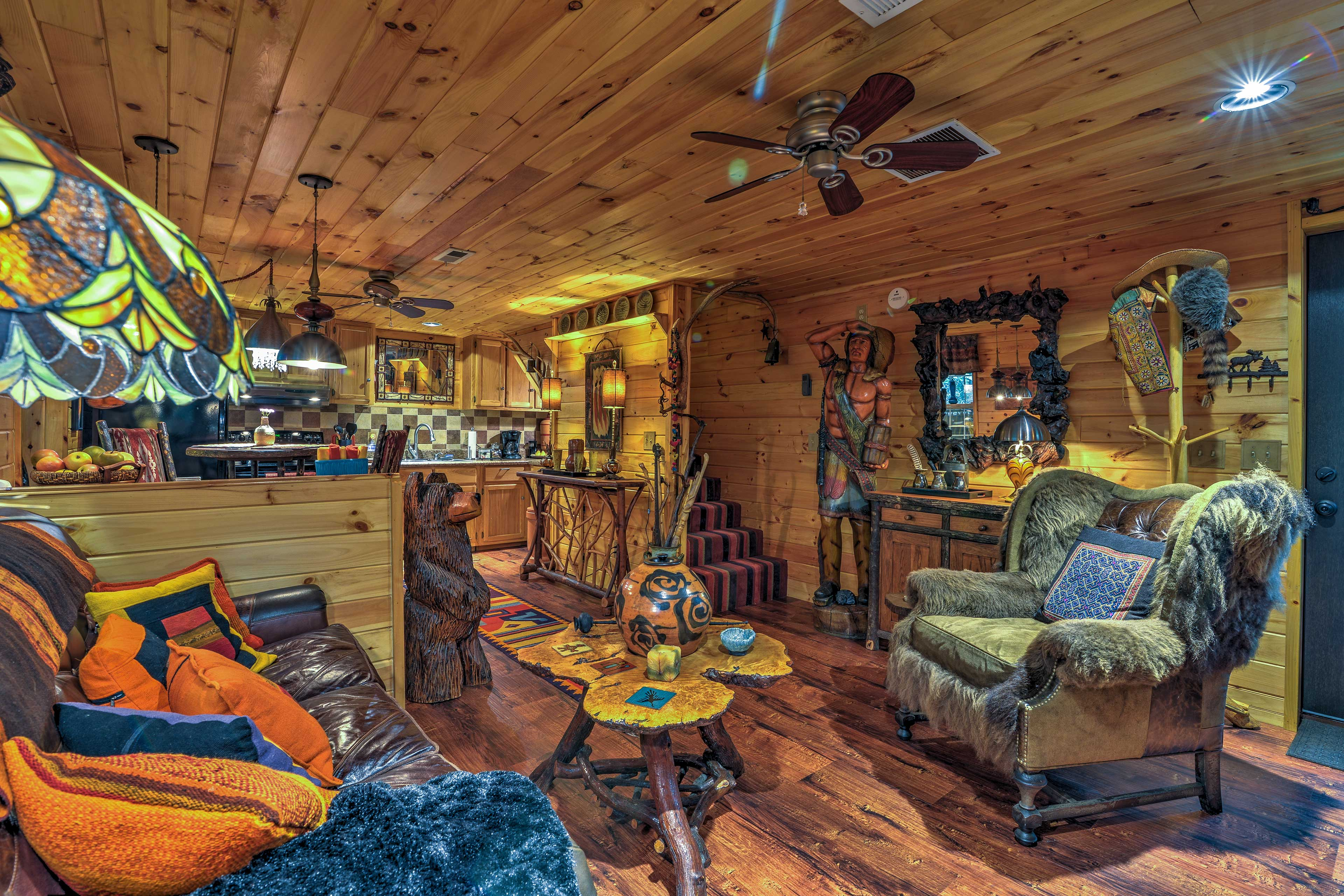 Warm up by the propane gas log fireplace and sit on the fur-lined leather chair.