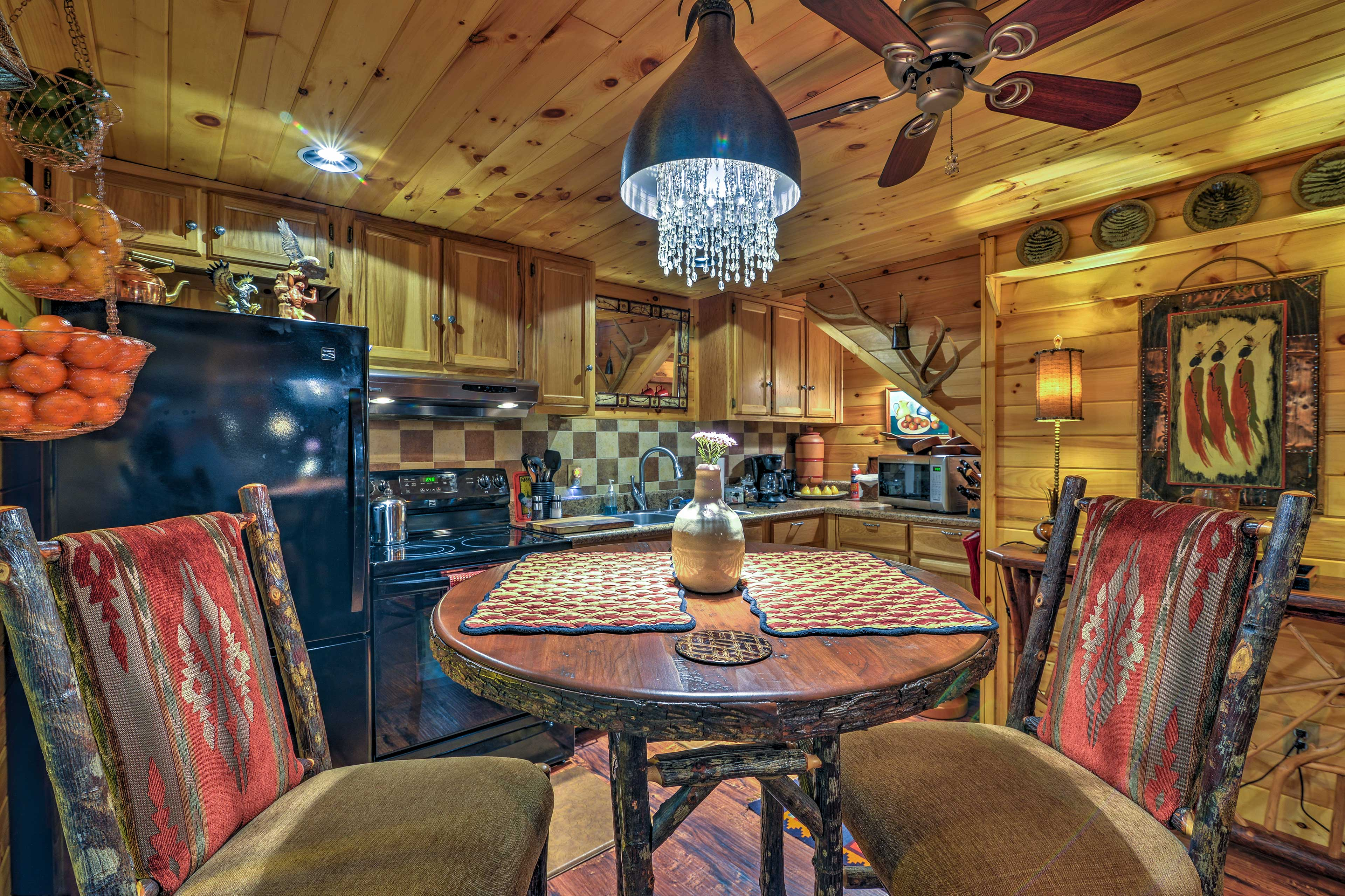 Sit down to a romantic meal at the rustic 2-person table in the kitchen.
