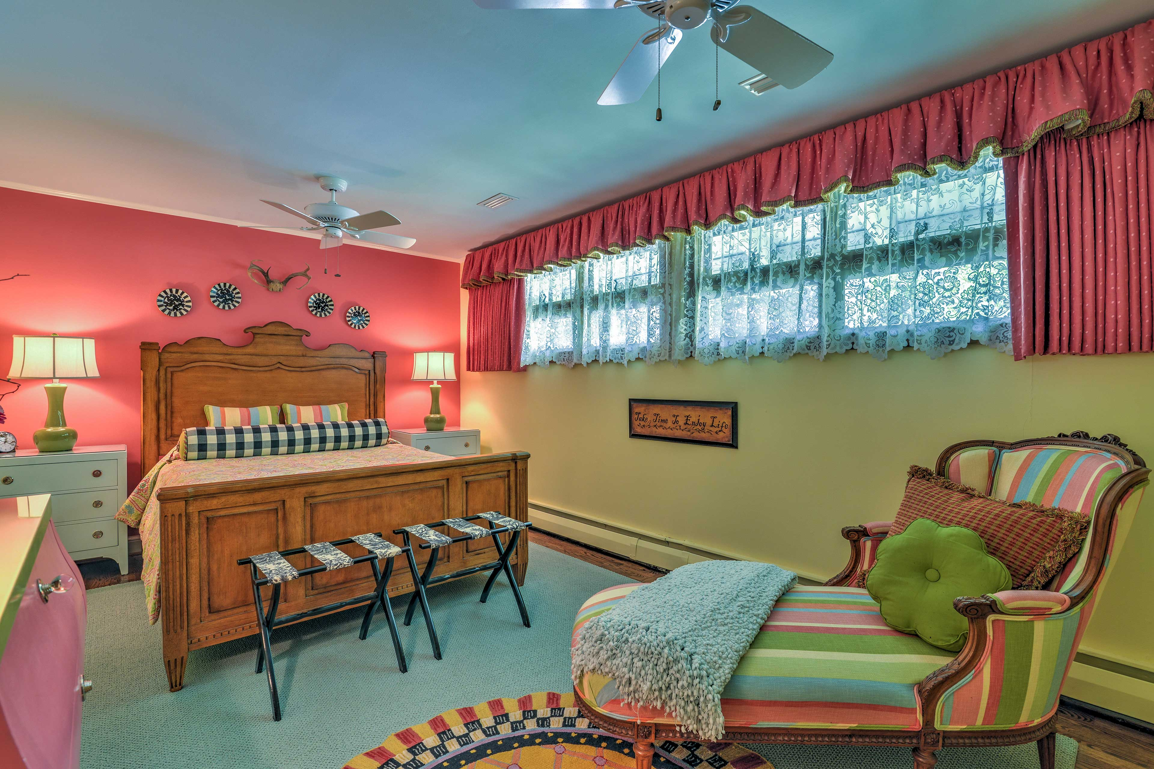 'Victoria's Room', a MacKenzie-Child's inspired haven has a plush queen bed.