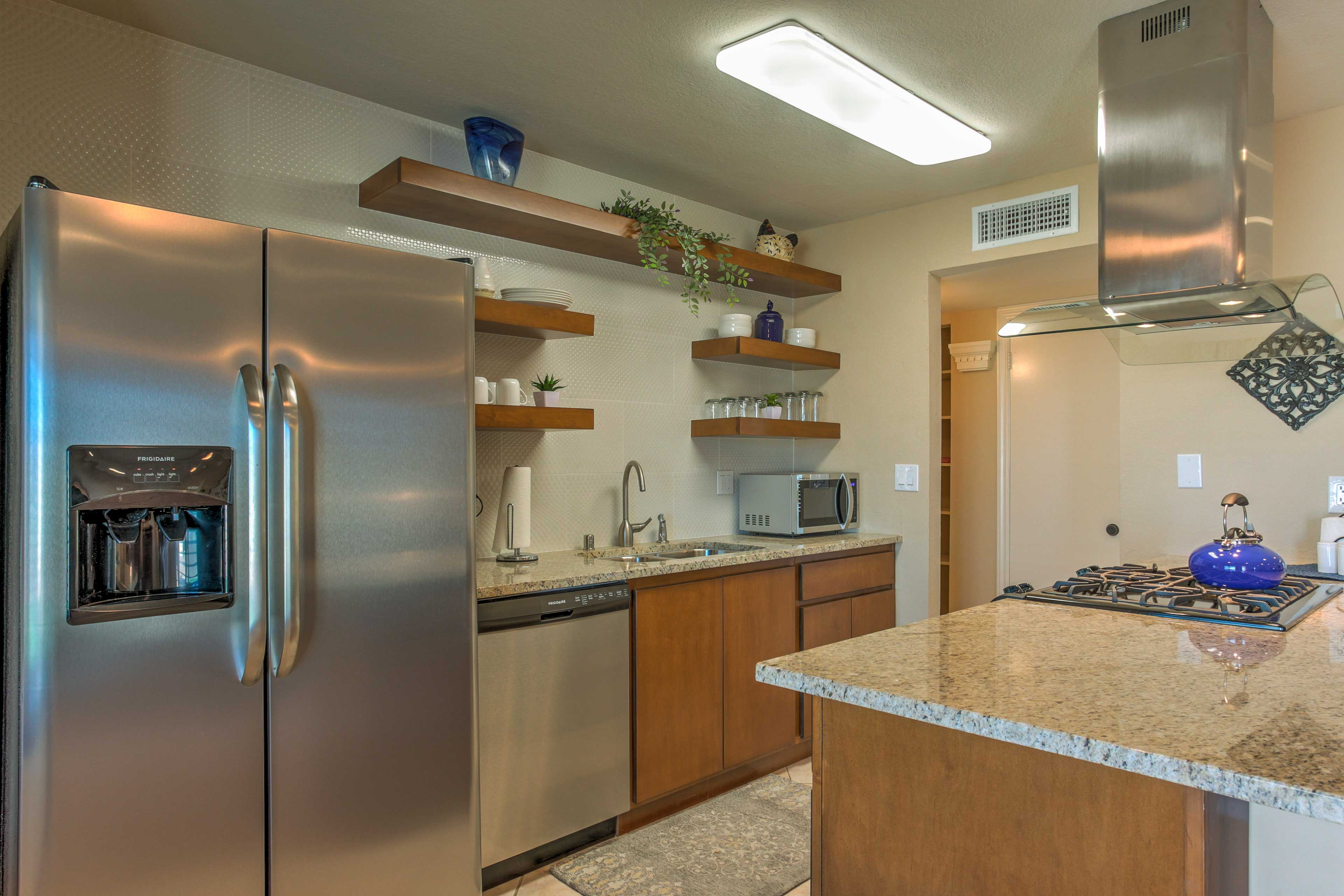 Whip up your favorite recipes in the full kitchen w/ stainless steel appliances.