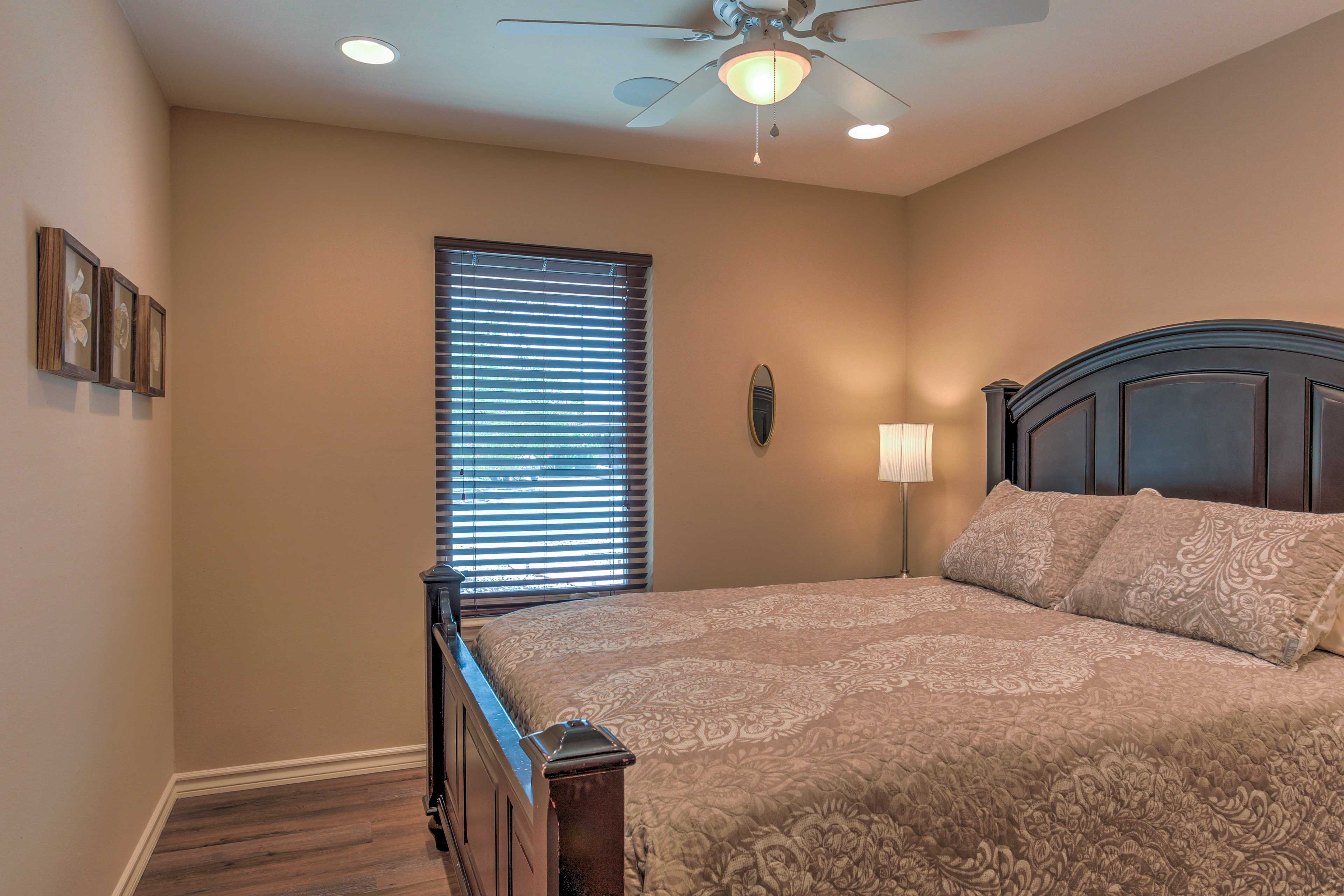 Each bedroom is tastefully appointed with plush bedding.