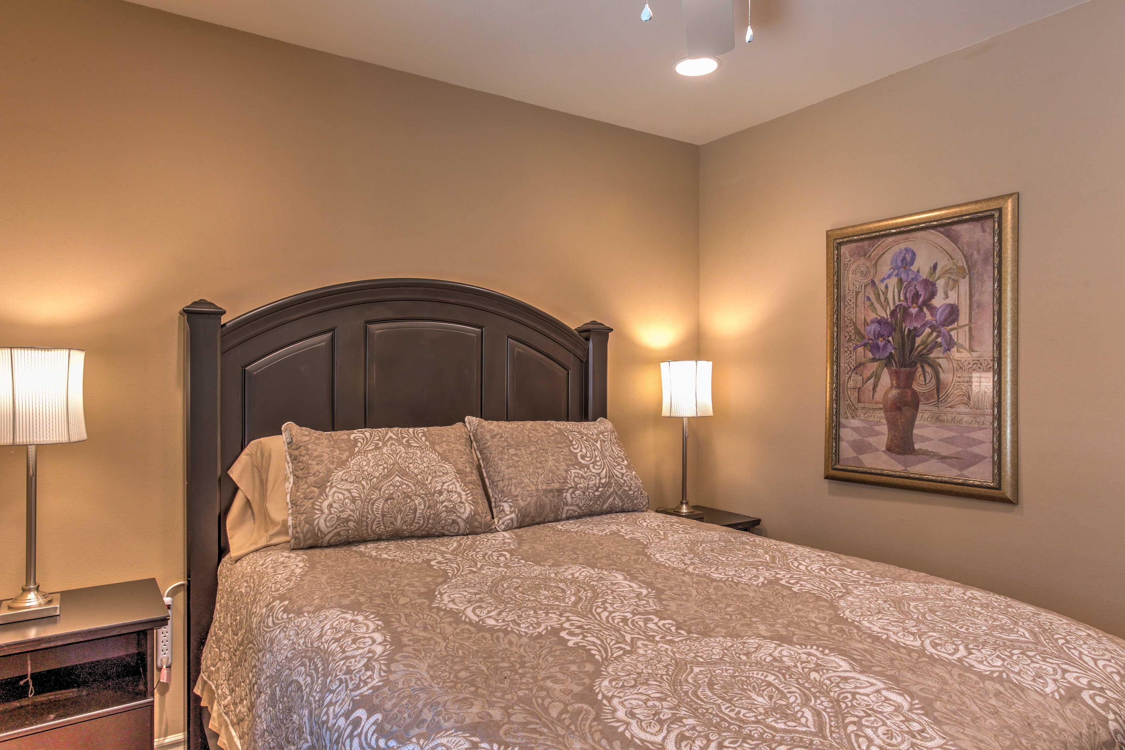 Sleep tight in this queen bed.