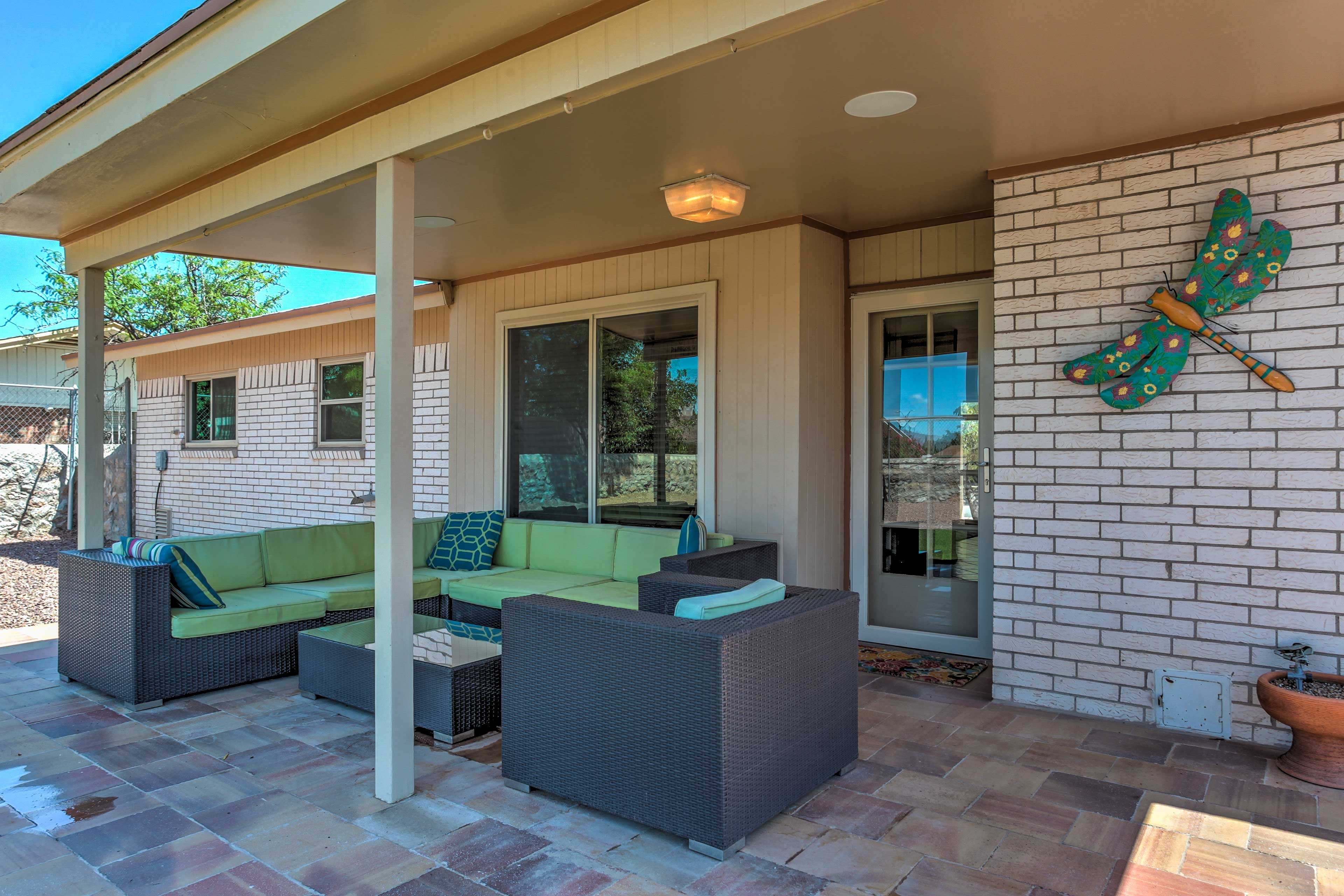 Enjoy the fresh air and a cool breeze on the covered patio.