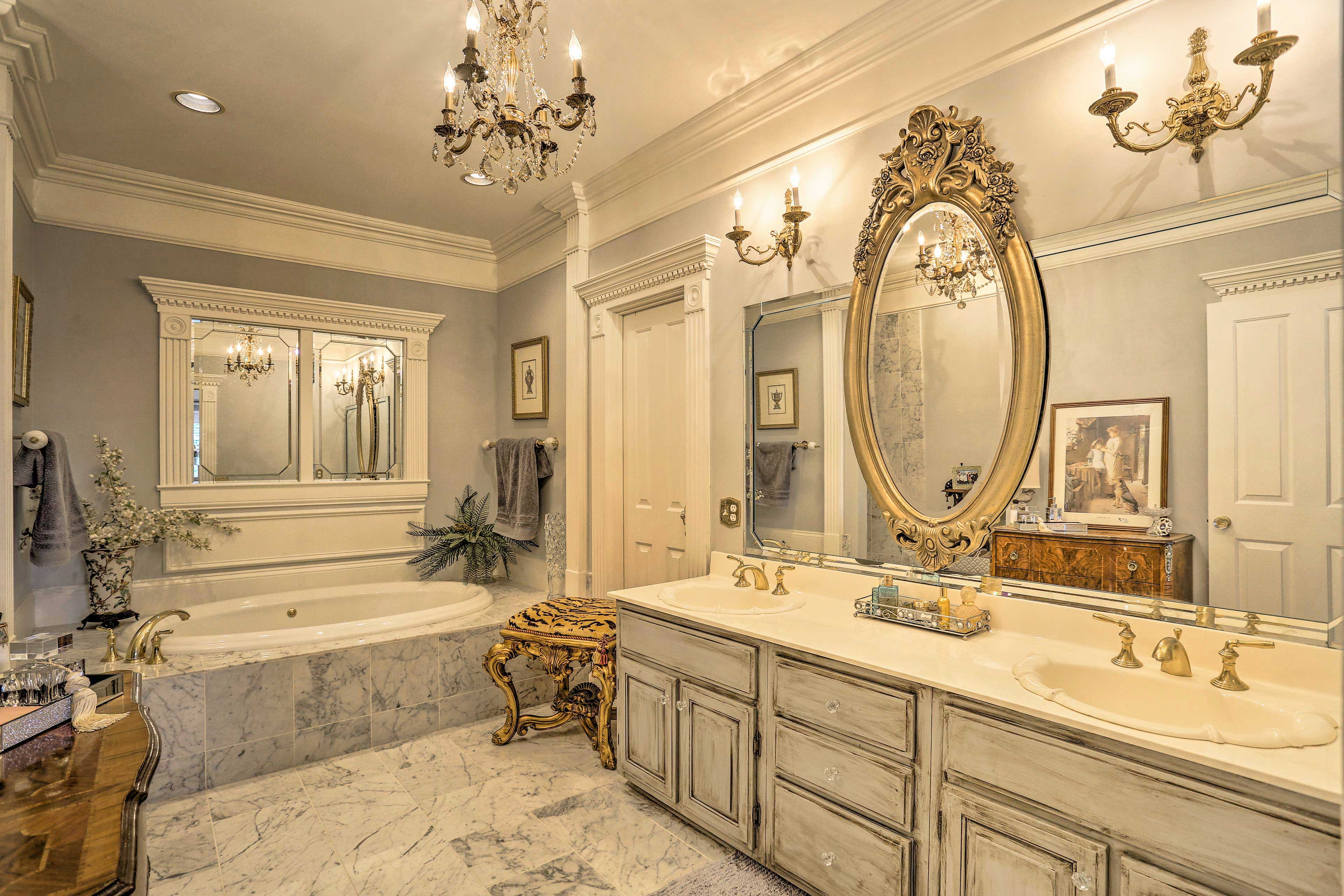 This bathroom features a huge vanity to get ready in the morning.