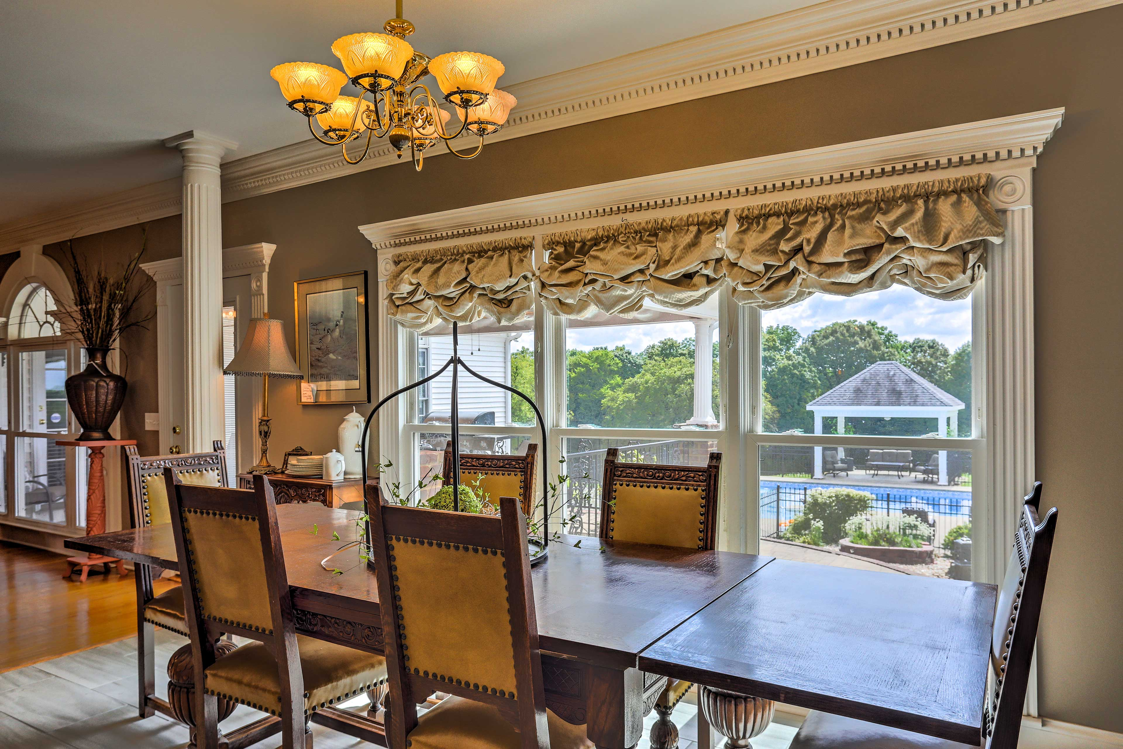 Pull up a chair to enjoy dinner with a view of the pool.
