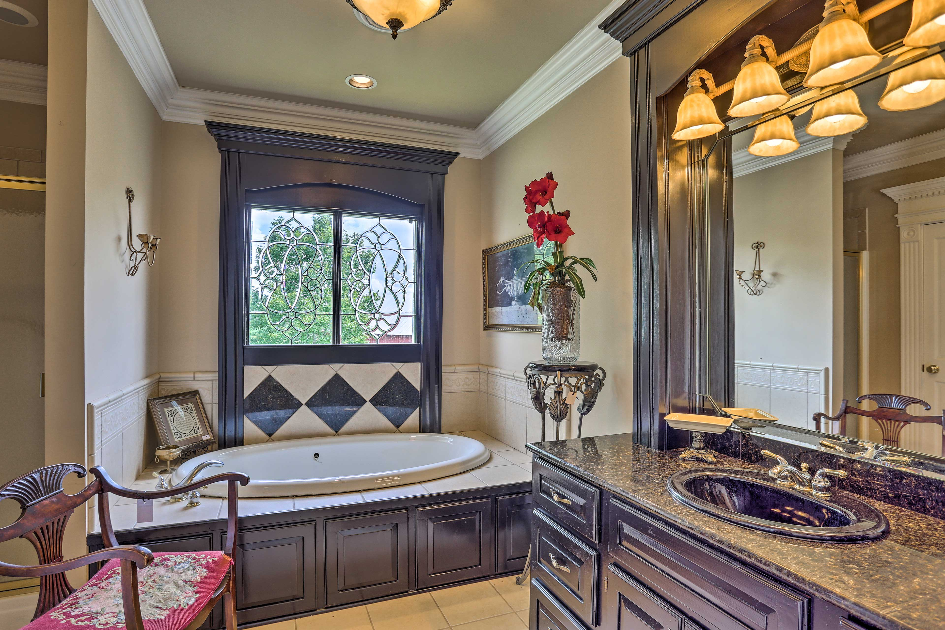 This bathroom also has a soaking tub!