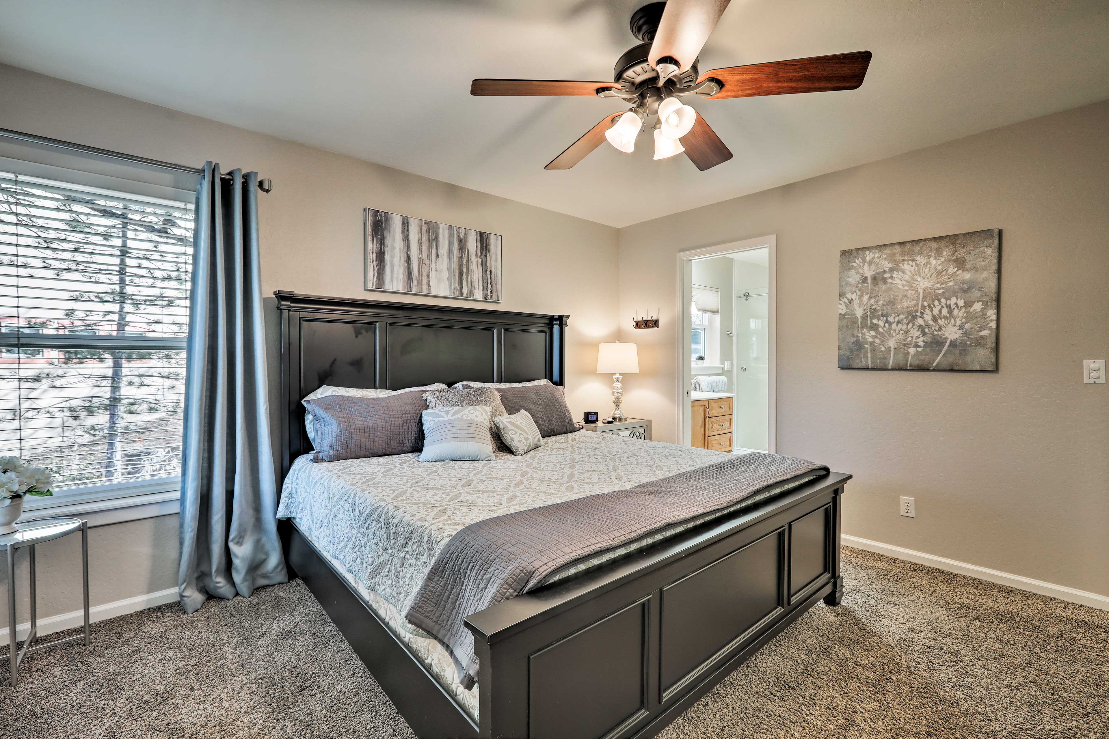 This second master bedroom features a king bed and full en-suite bathroom.
