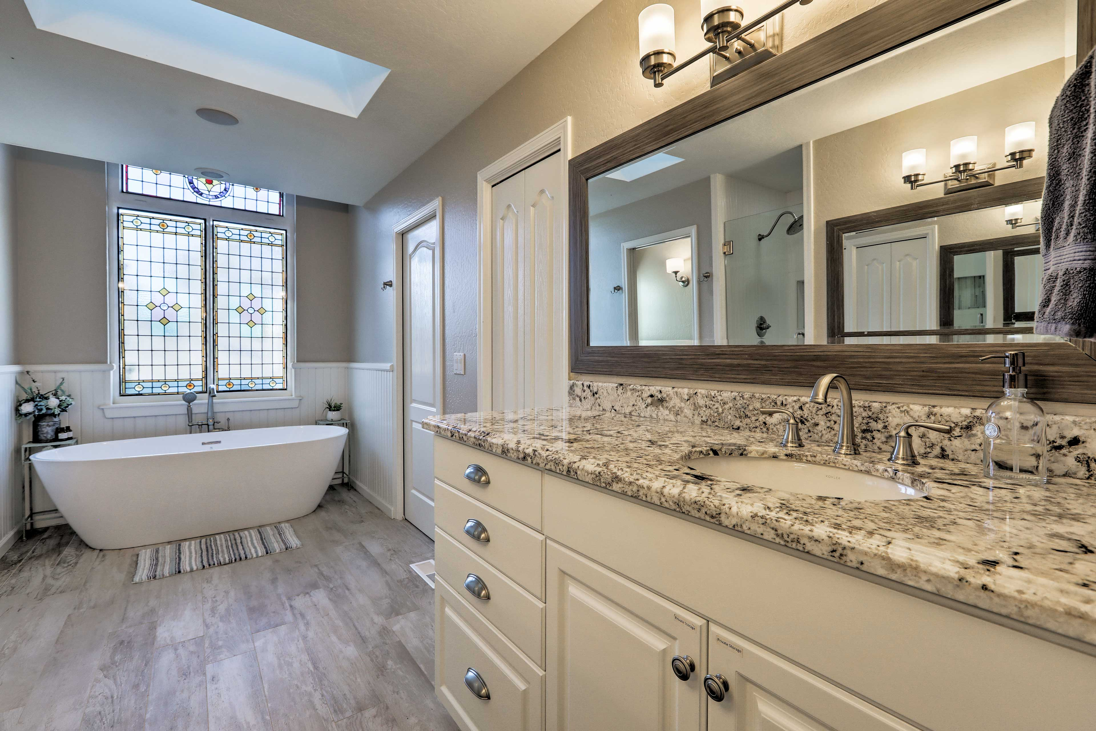 This private en-suite bathroom includes a soaking tub and walk-in shower.