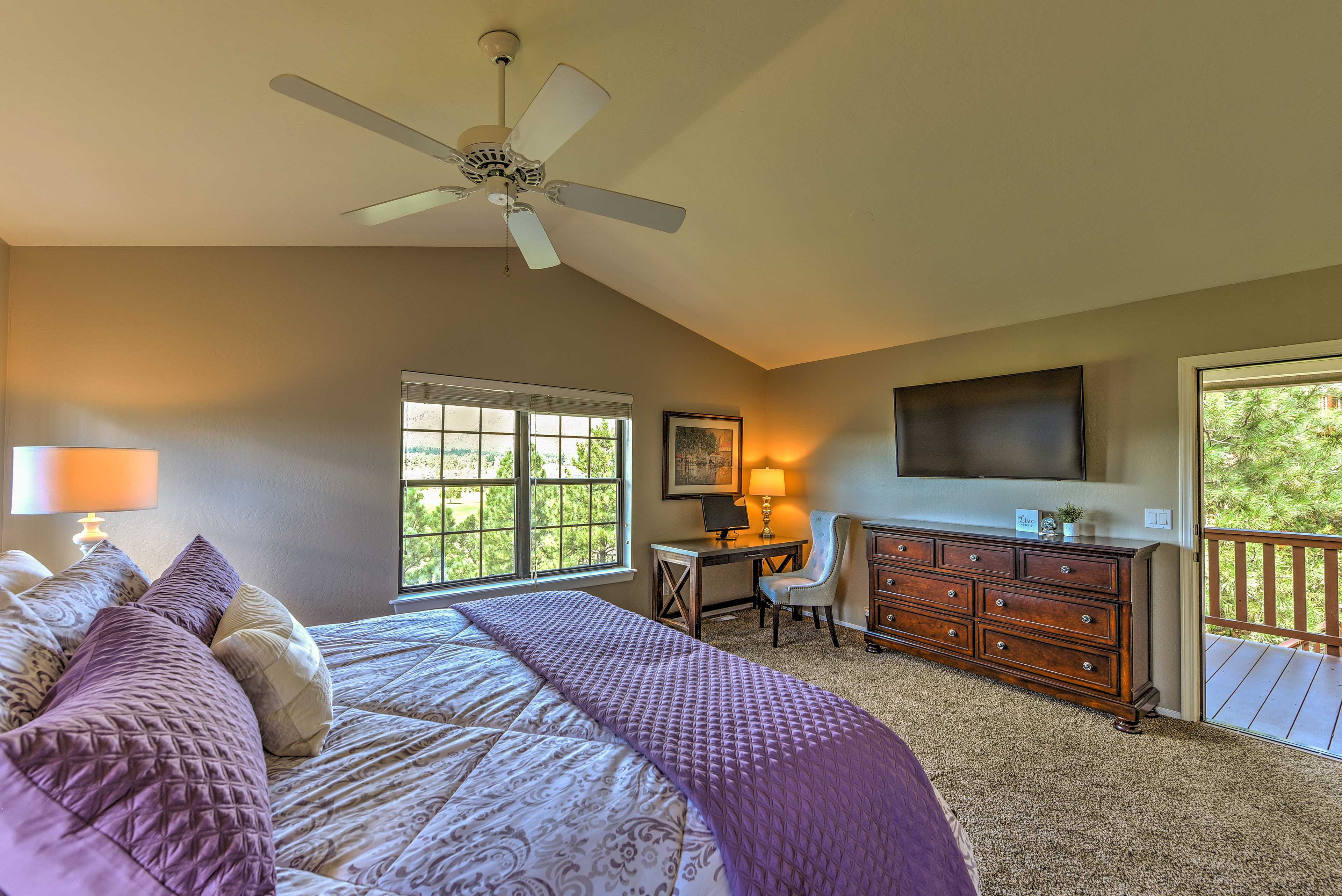 The master suite boasts private access to the deck and a king bed.