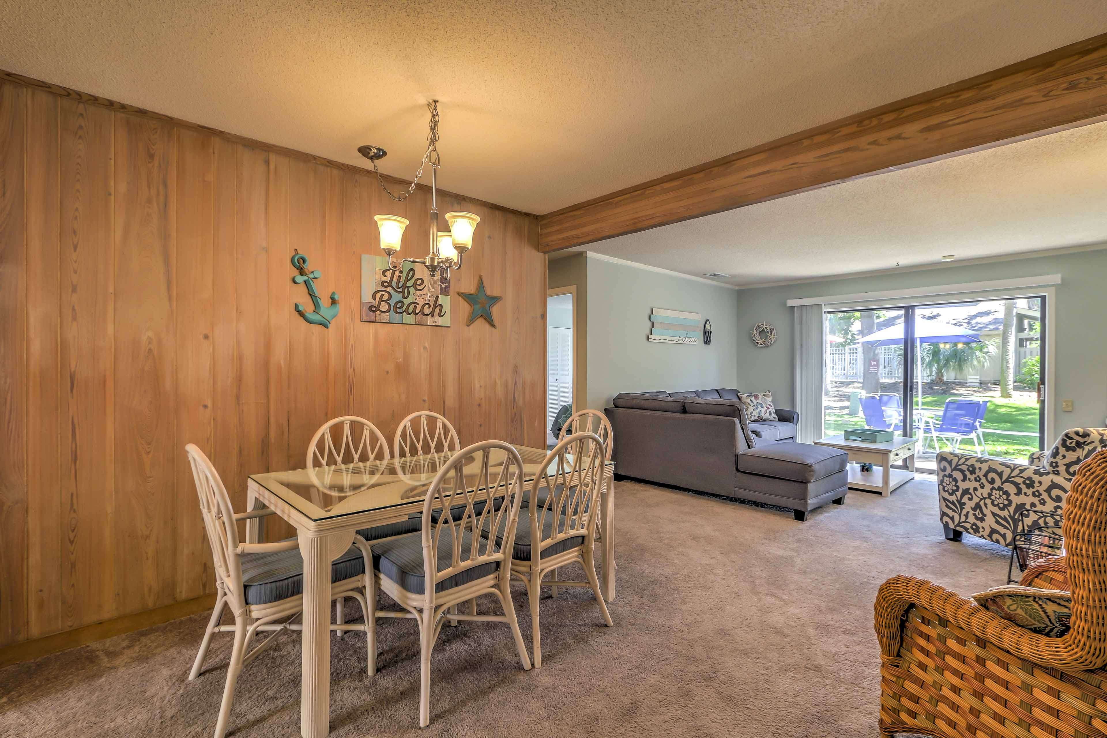 The condo has an open layout from the living room to the kitchen and dining area