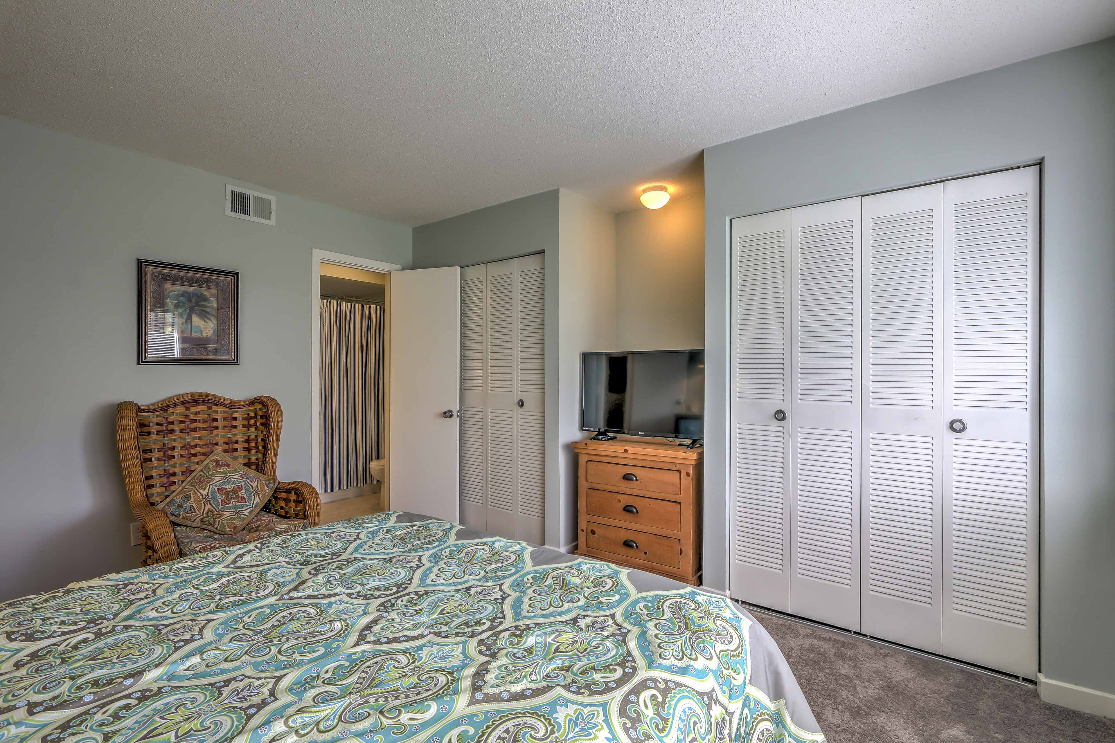 This master bedroom has a flat-screen cable TV and an en-suite bathroom.