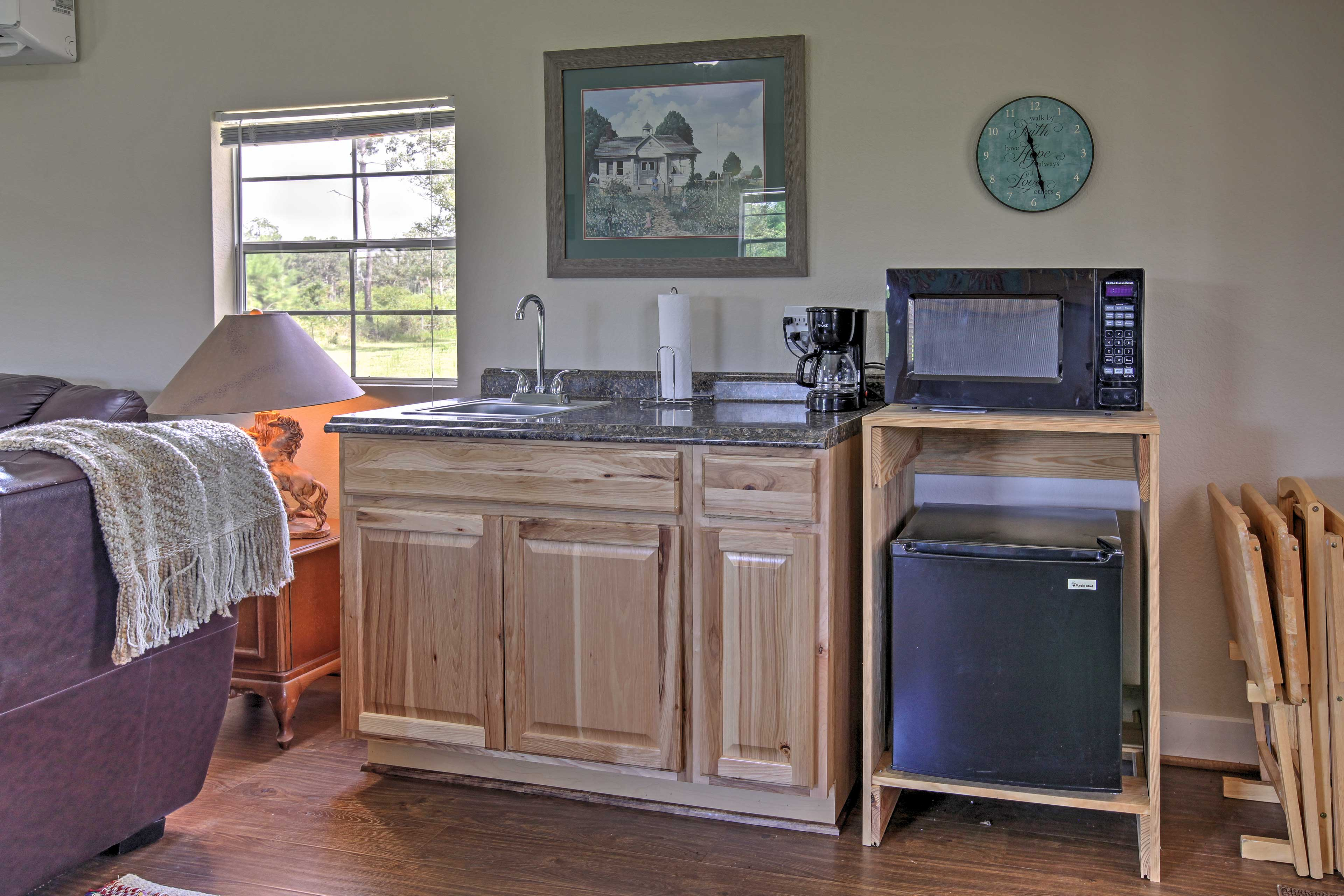 Step inside where you'll be immediately greeted by a well-equipped kitchenette.