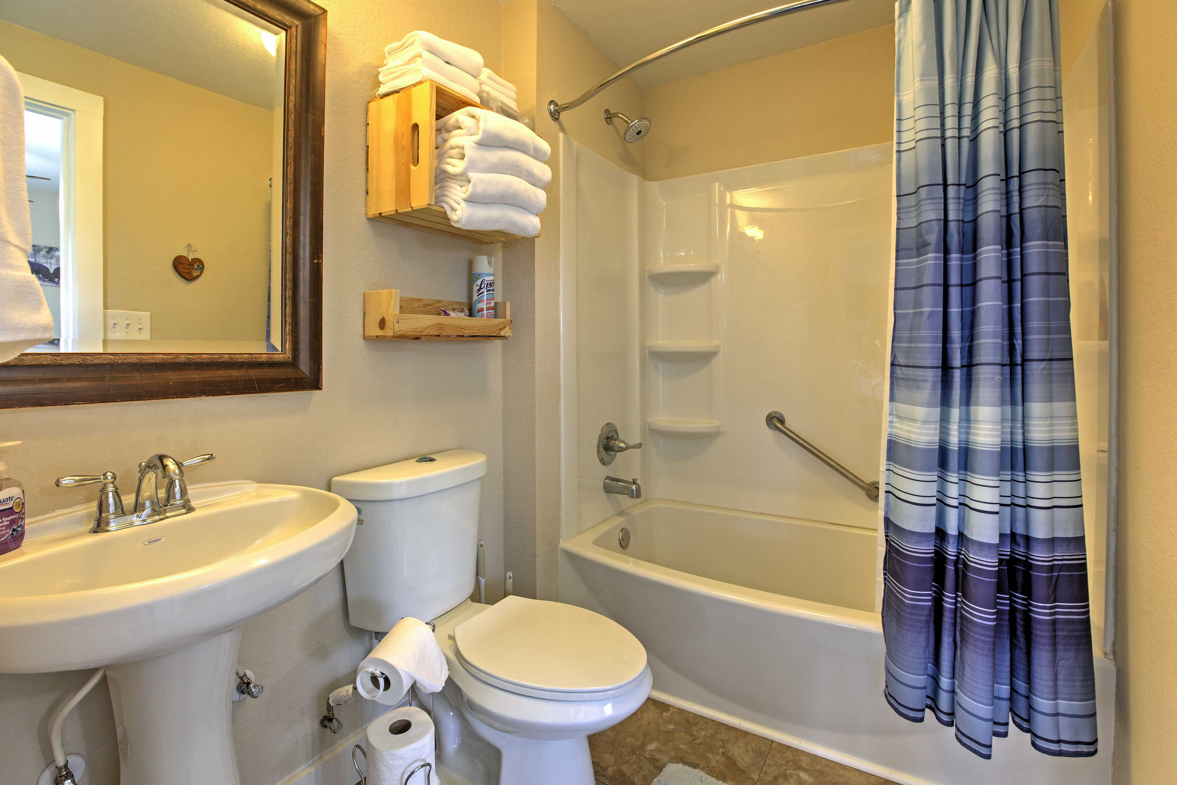 Freshen up in the home's bathroom, which boasts a shower/tub combo.