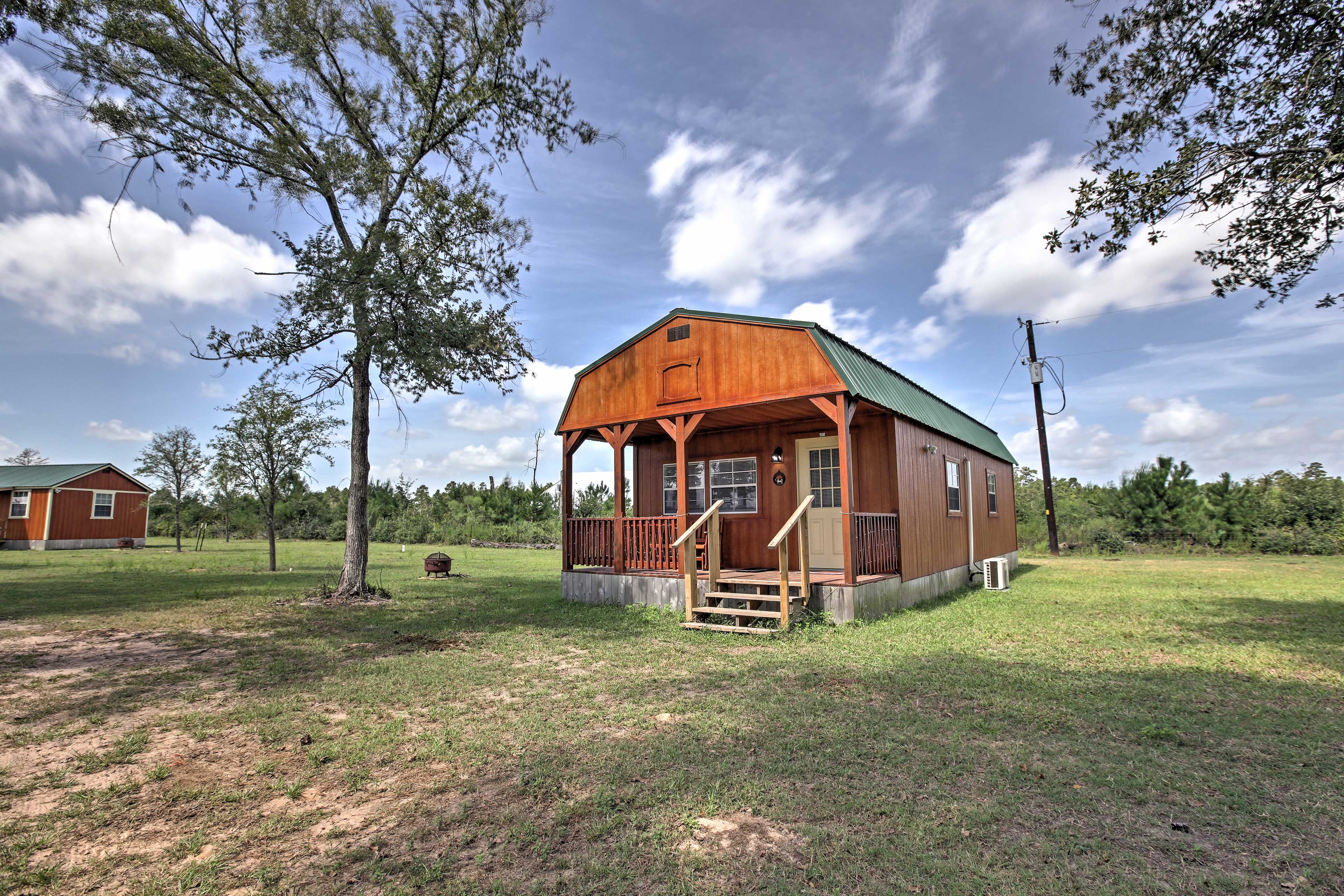 This home boasts a large yard of grassy land for you to enjoy during your stay.