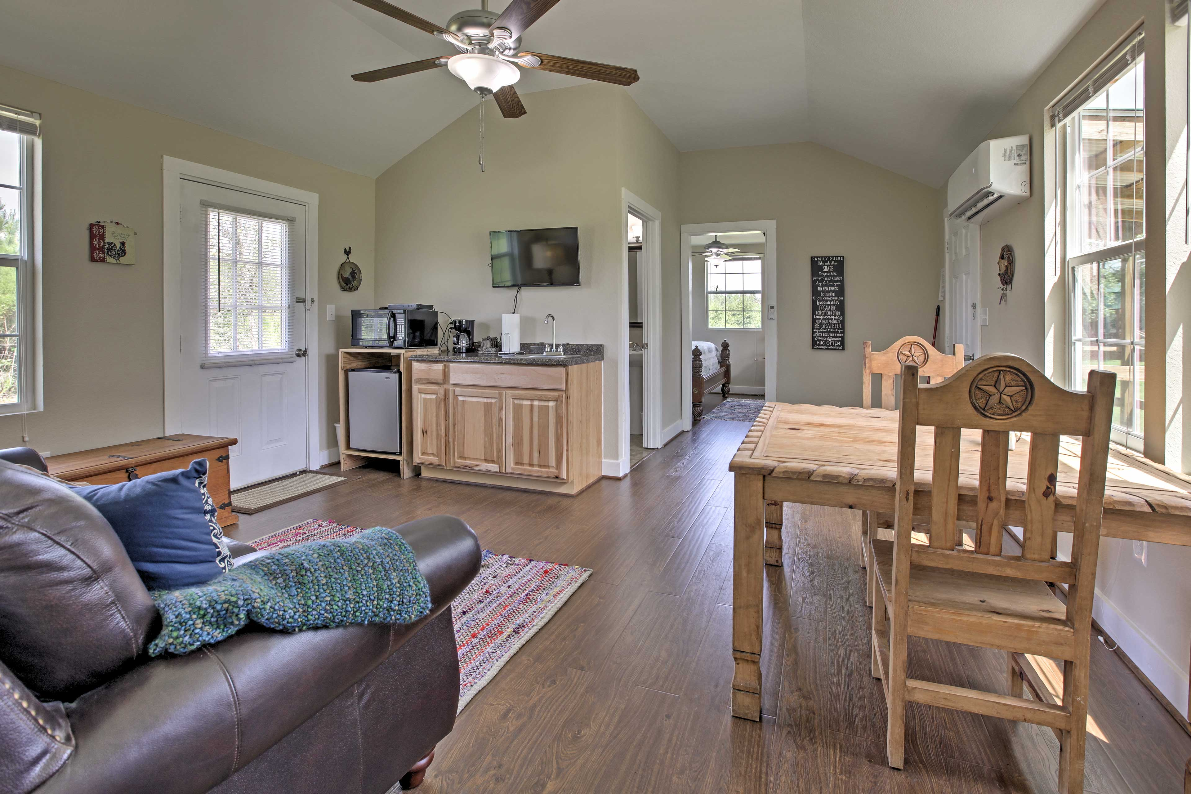 The cabin's interior boasts an open-concept layout and quaint decor.