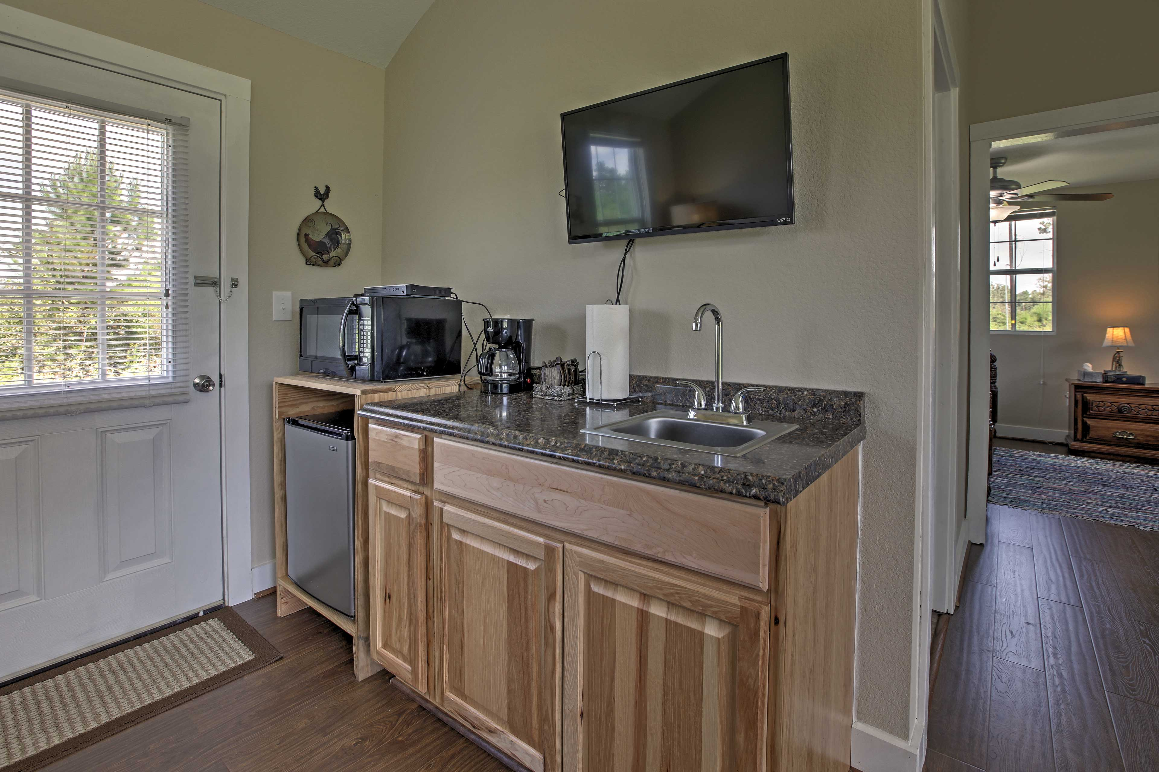 As you step inside, you'll be greeted by the well-equipped kitchenette.