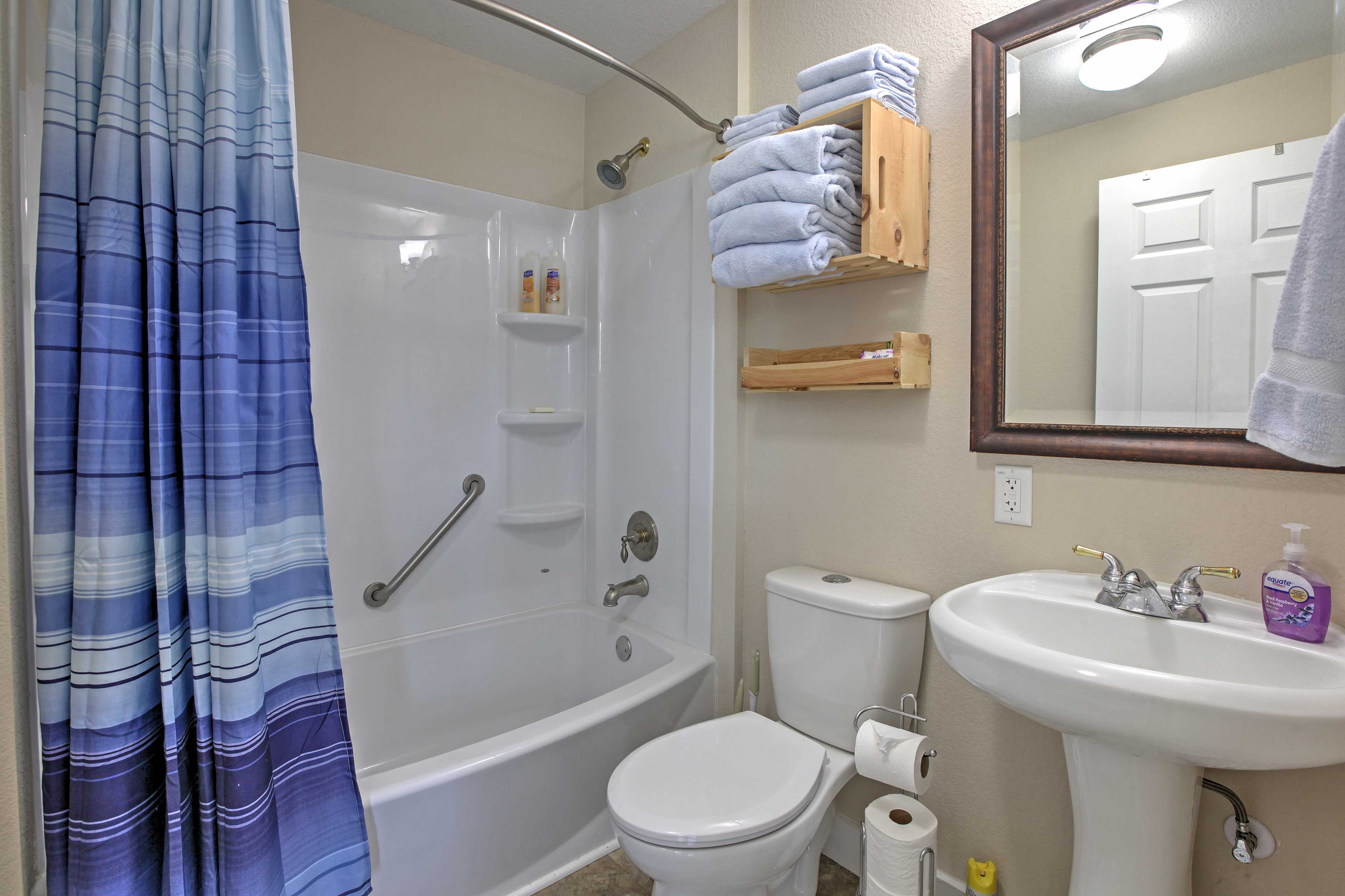 Clean up for the day in the home's bathroom, which boasts a shower/tub combo.