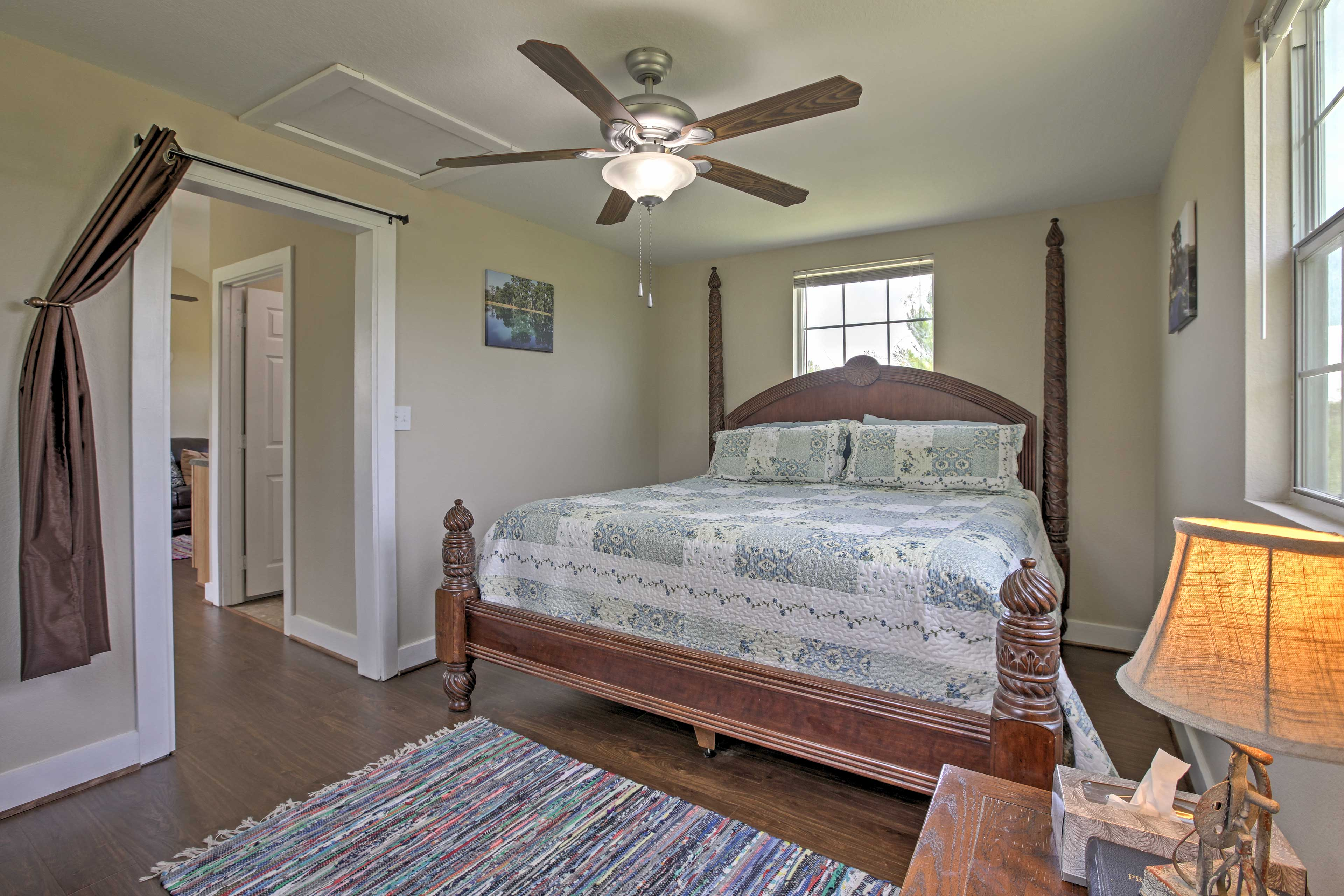 Another bedroom features a lovely king bed!