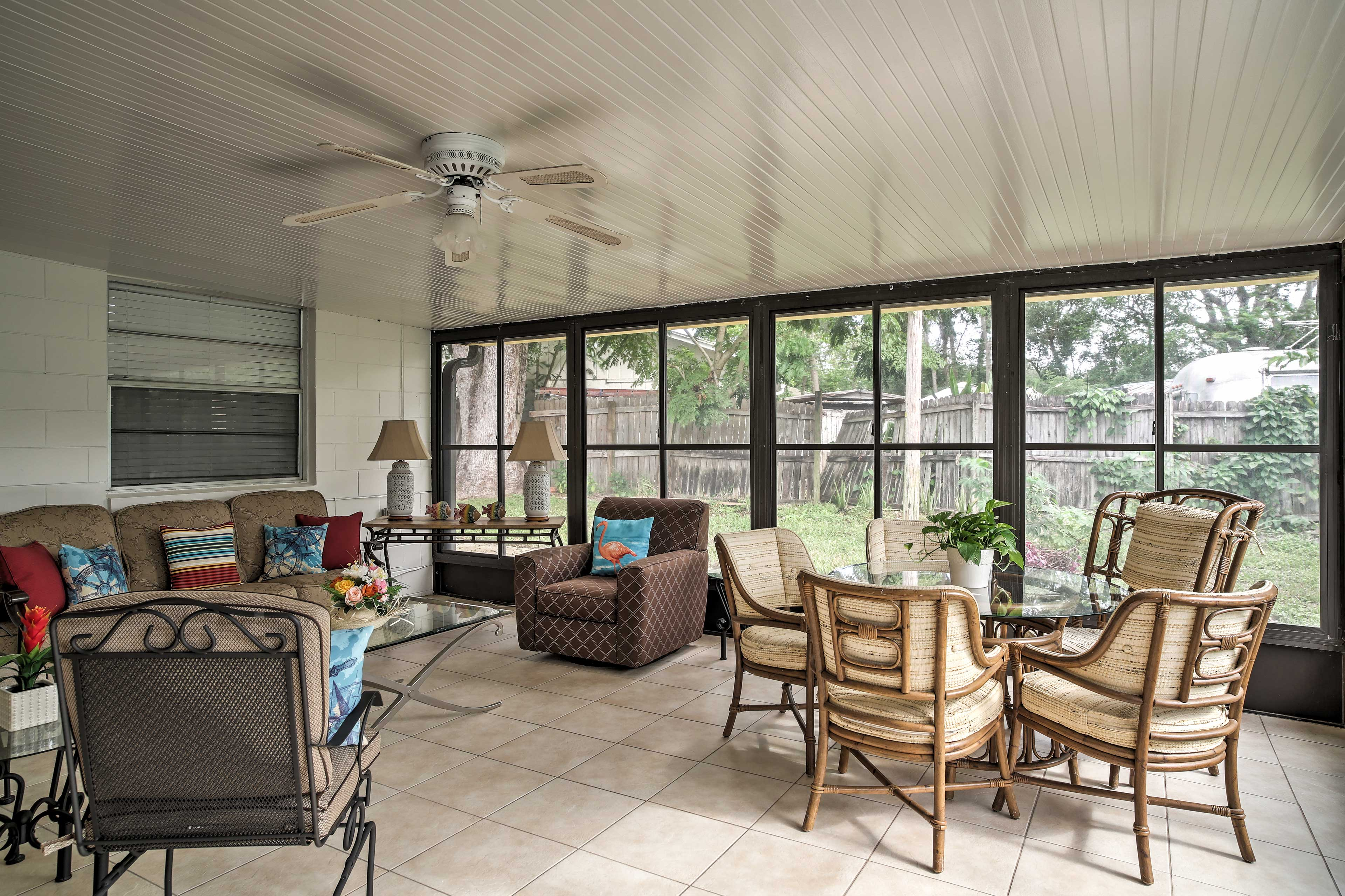 Spread out and relax with your morning coffee in the sunroom.