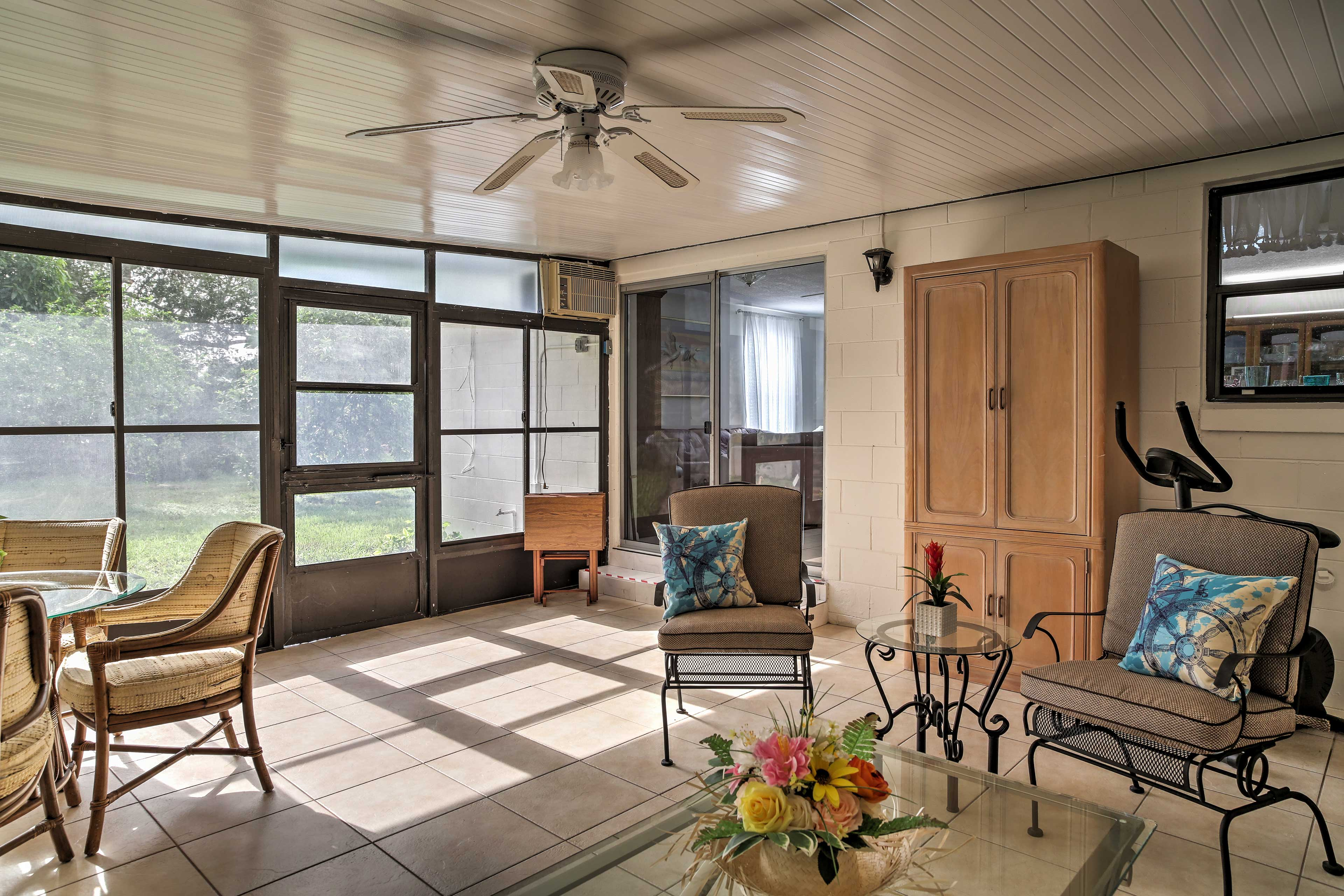 Bask in the warm natural light filling the sunroom.