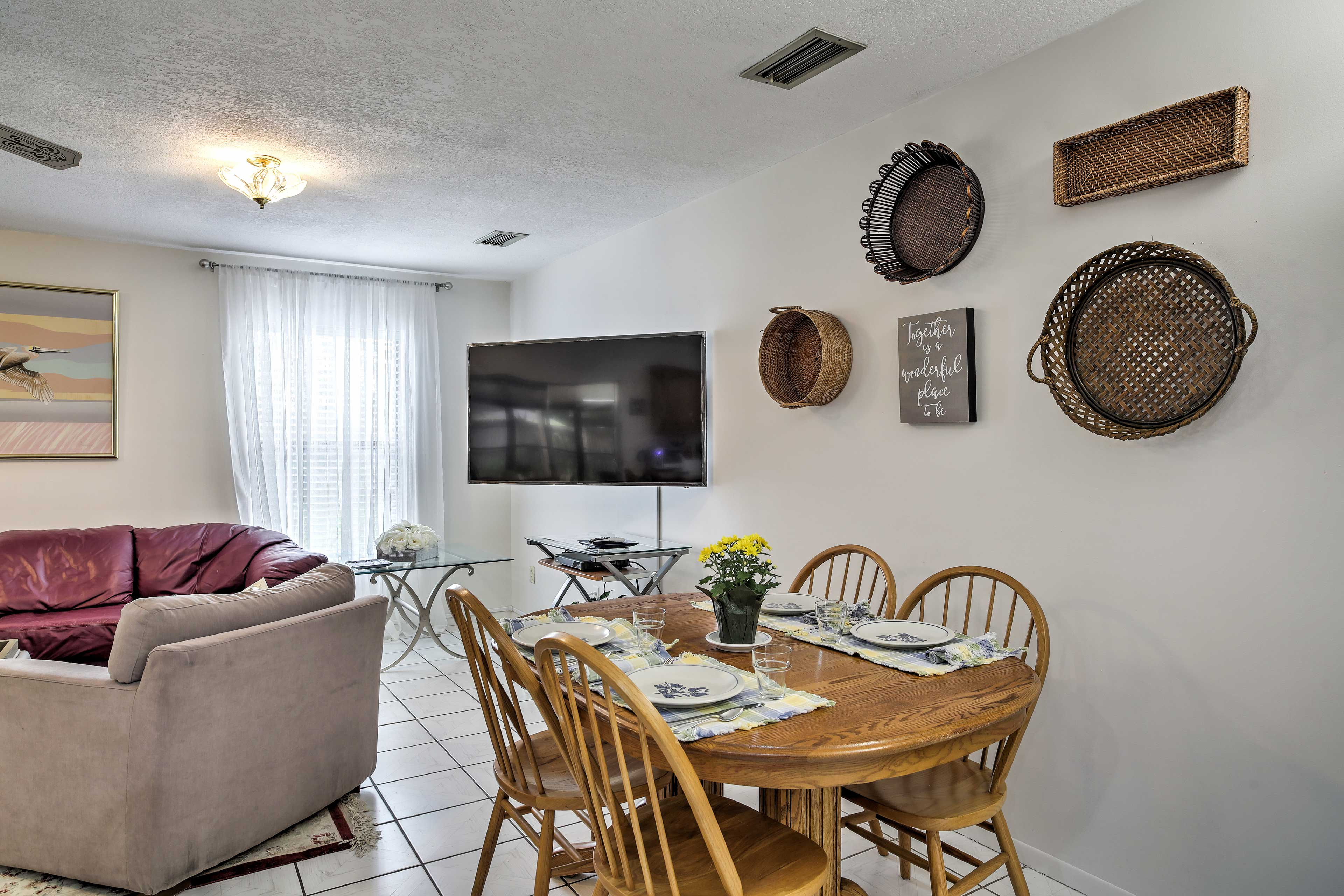 Tile floors lead your from the kitchen to the family room.