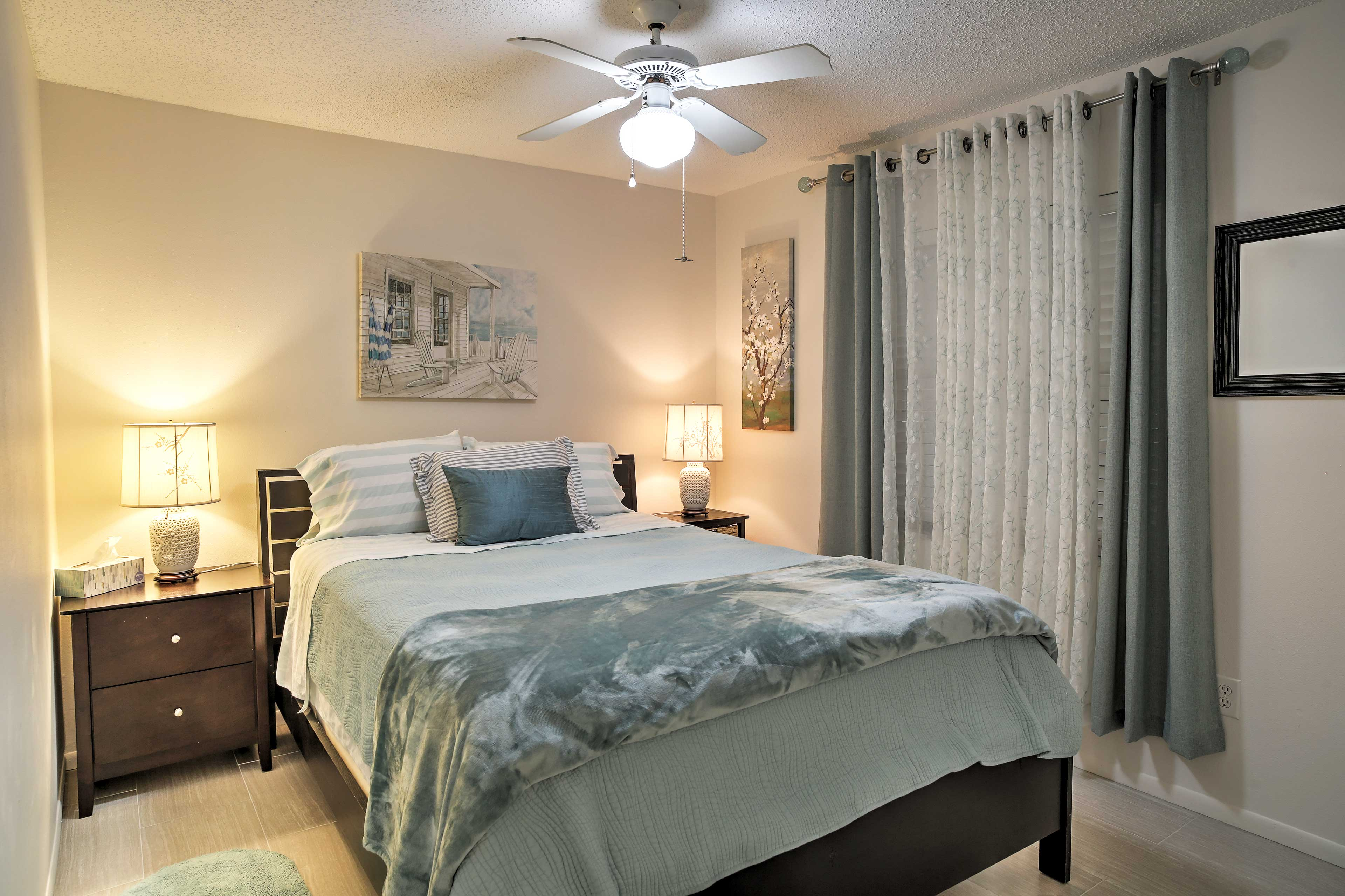 Two guests can enjoy restful nights on this queen bed.