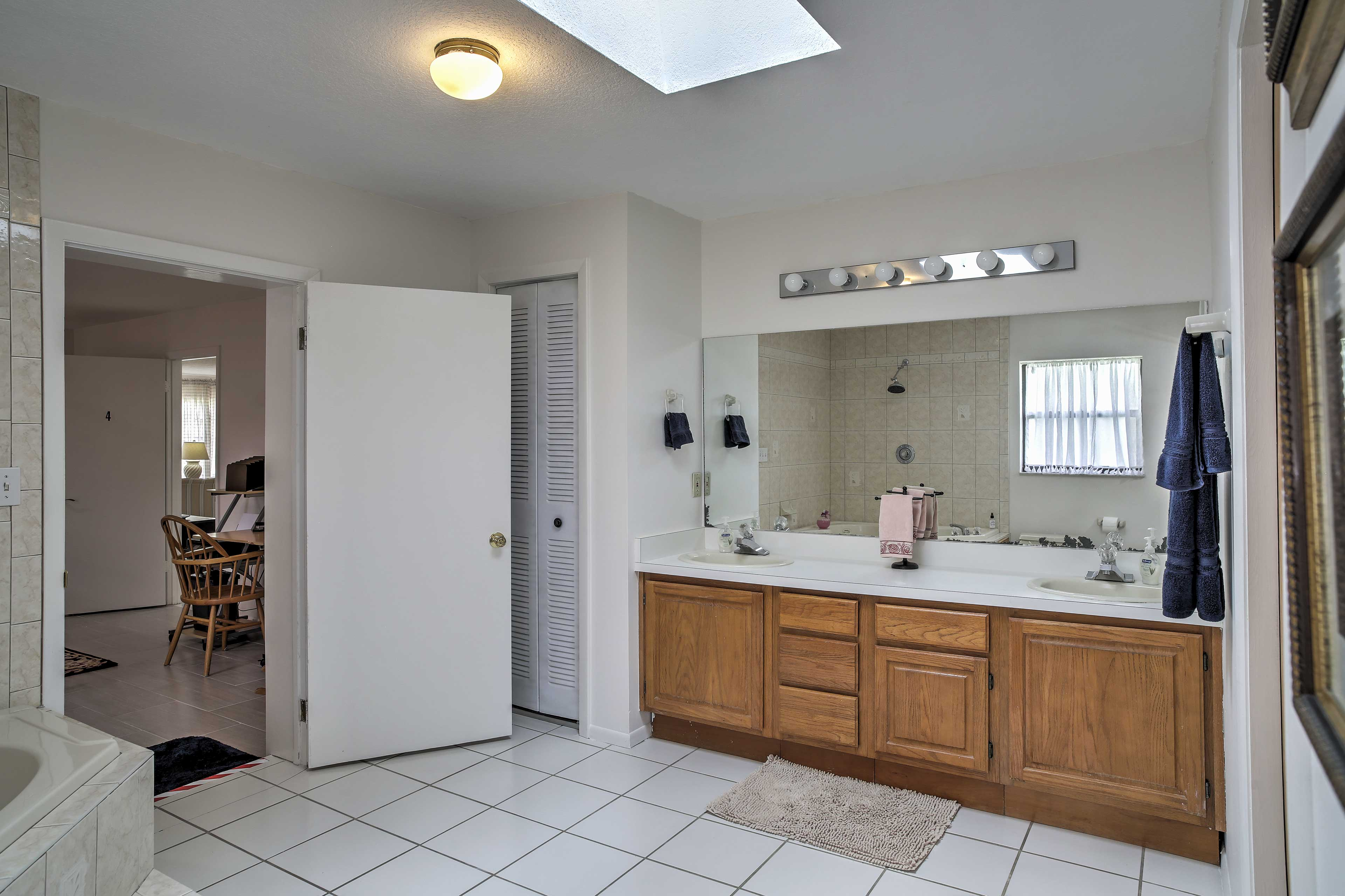 The full bathroom features double sinks.
