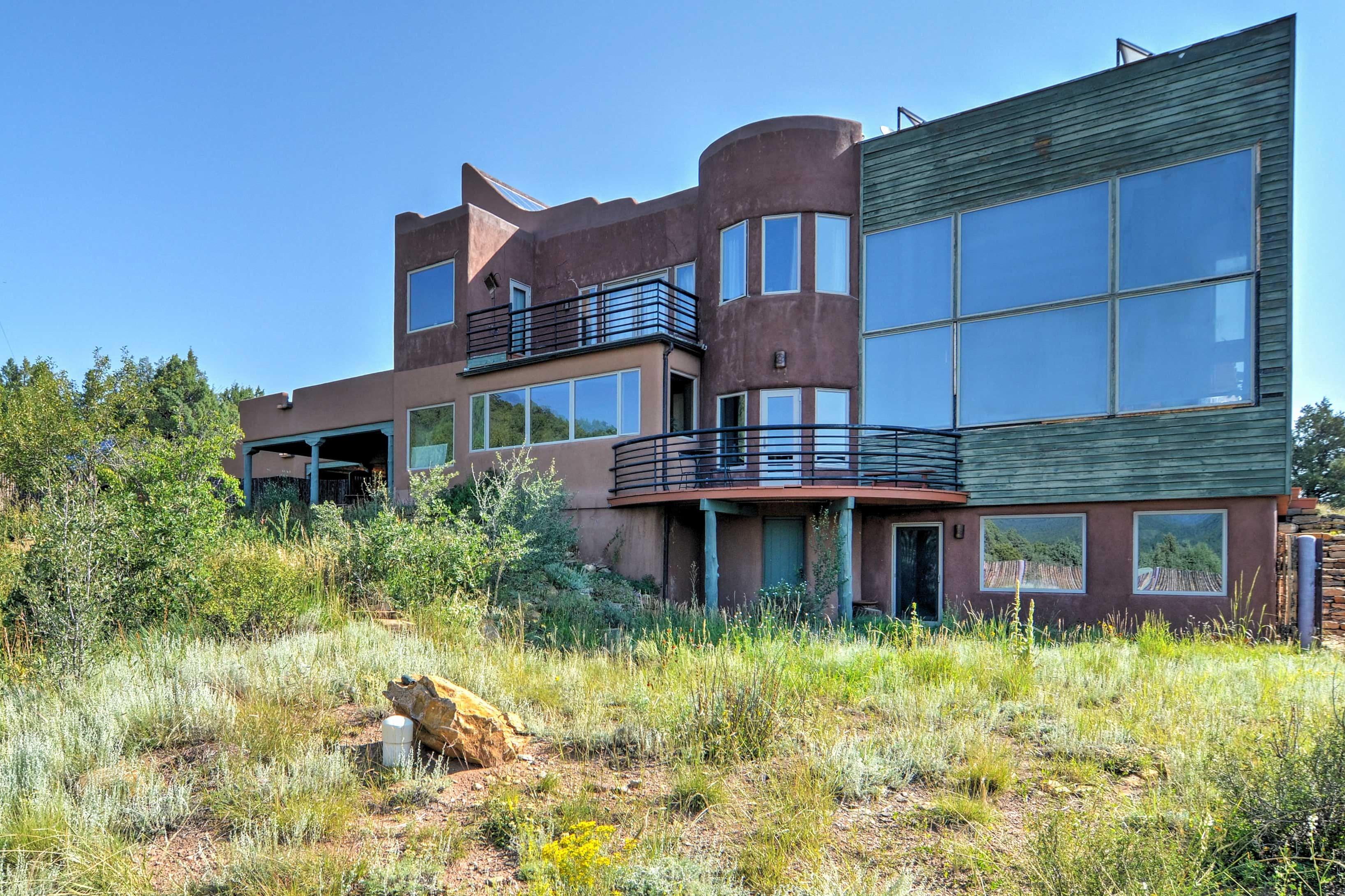 A restorative getaway awaits at this 4-bedroom, 3-bathroom vacation rental home.