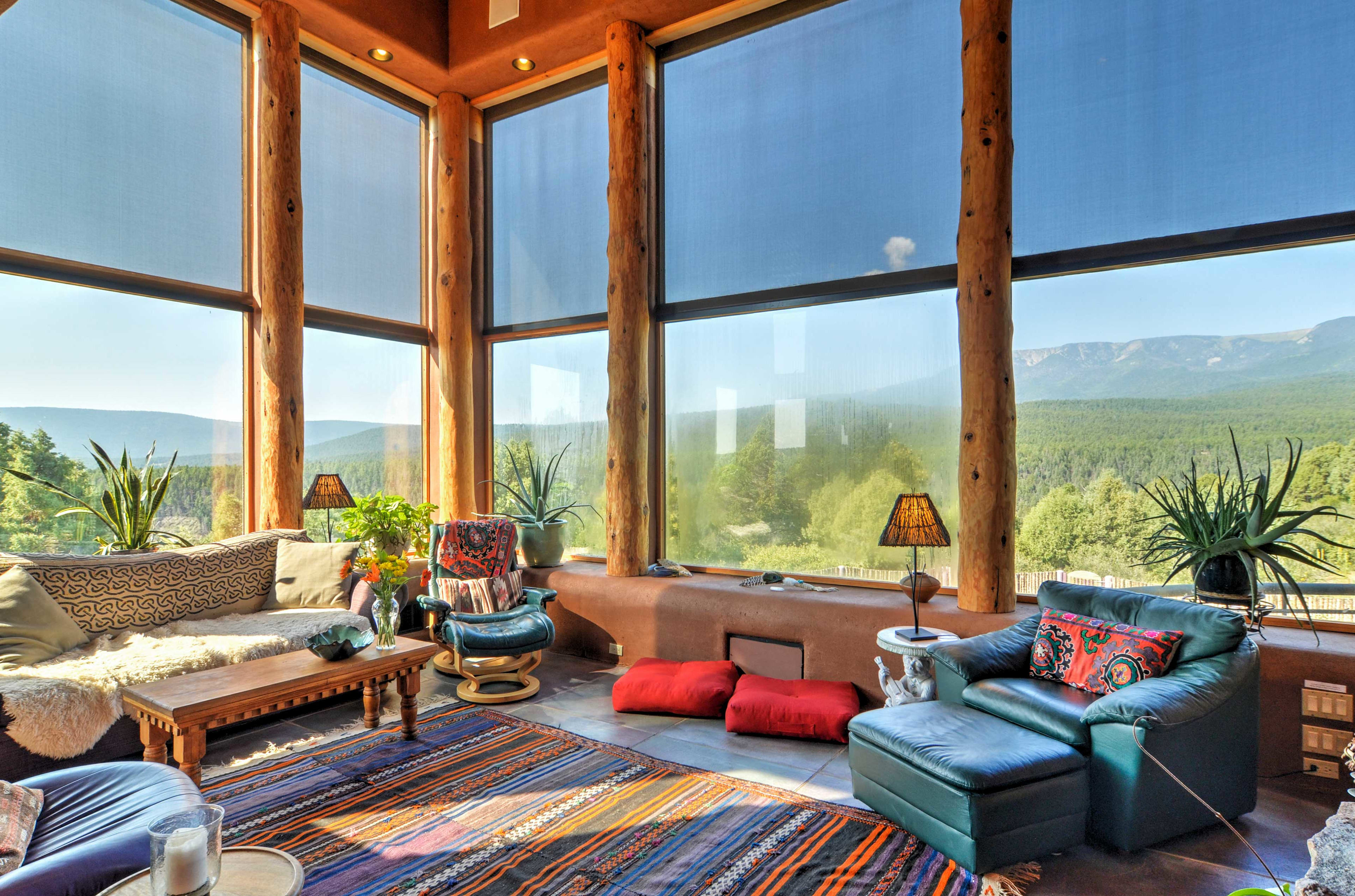 Nestled on a 10-acre hilltop, this home for 14 has a hot tub and mountain views.