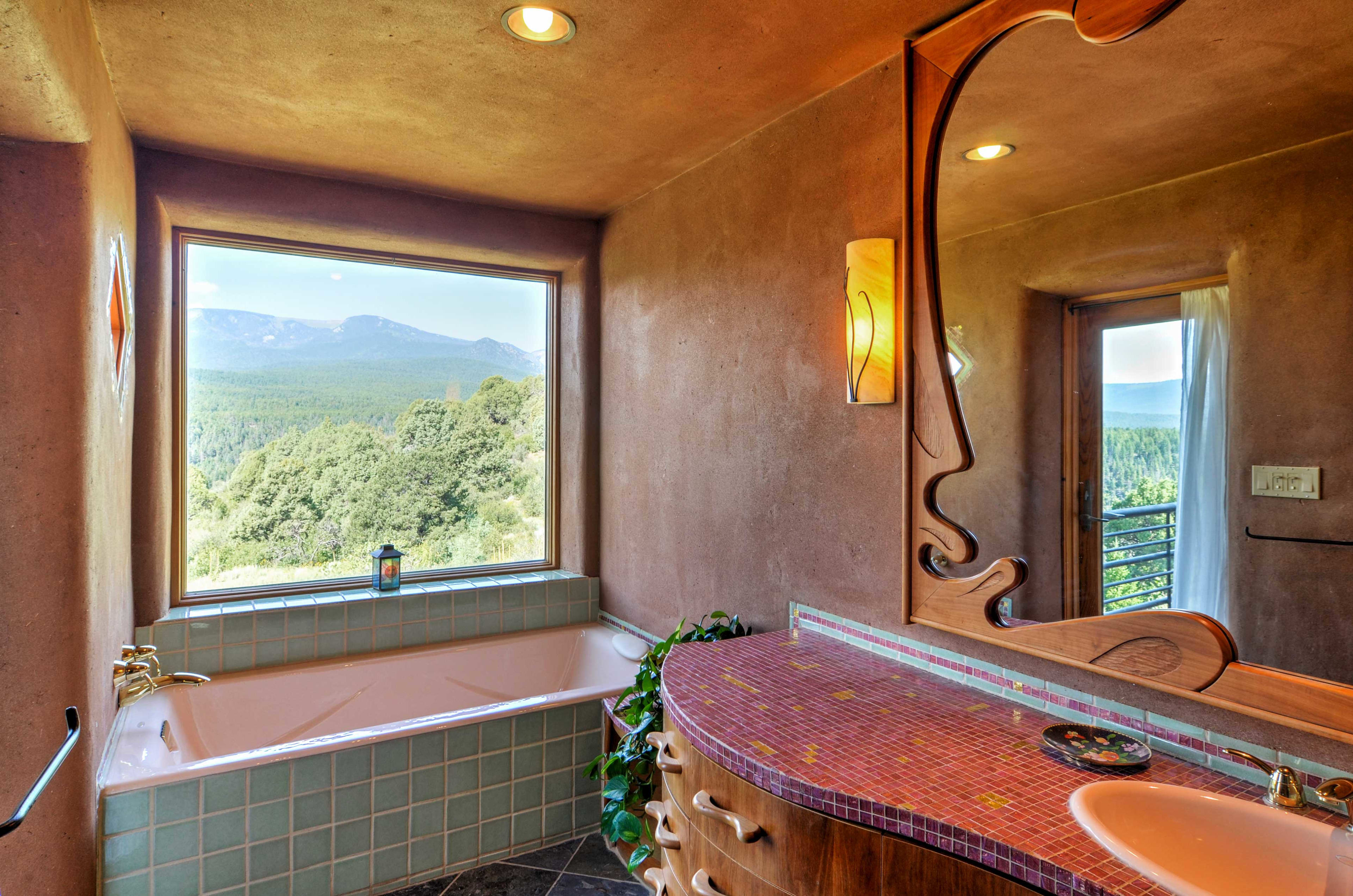 The en-suite bath features a tub with spectacular views.