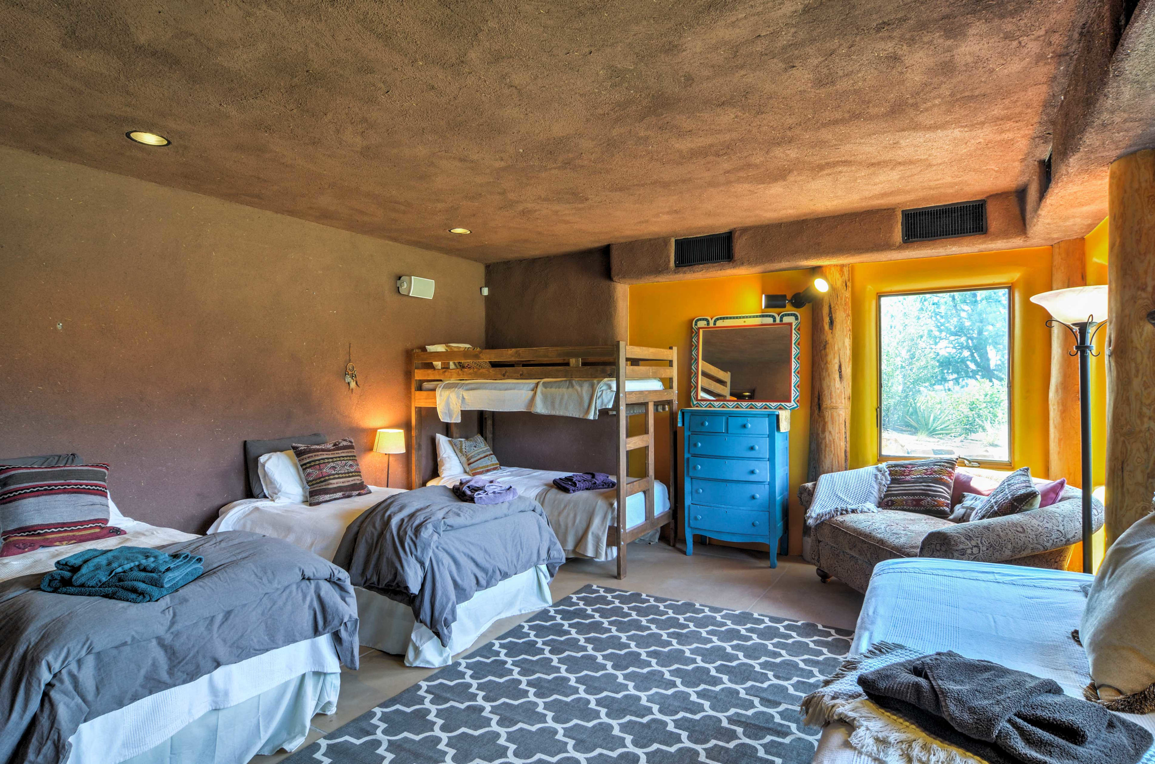 This room includes 2 twin beds, a twin-over-twin bunk bed and futon.