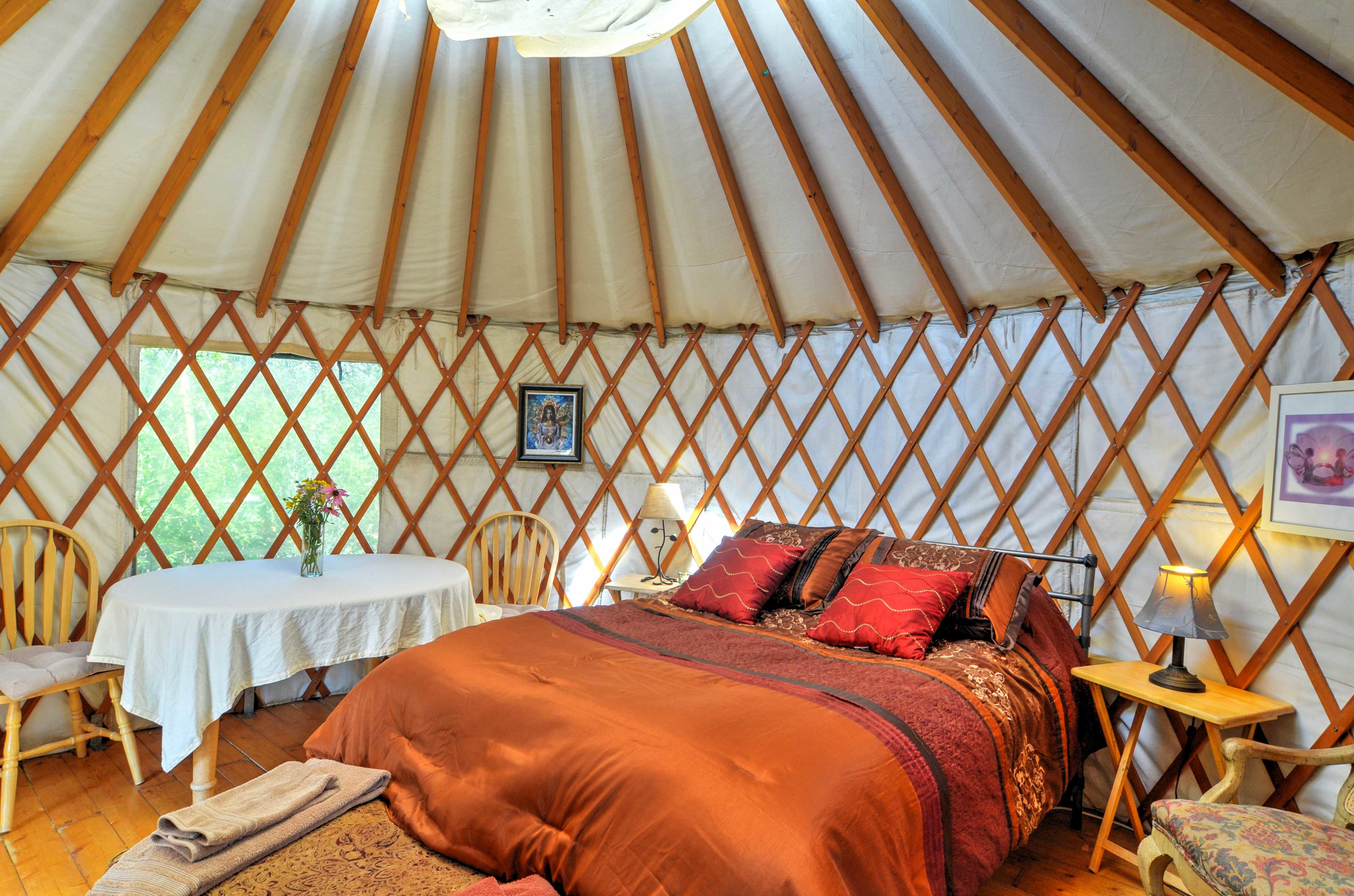 The Yurt features a heater and plush queen-sized bed.