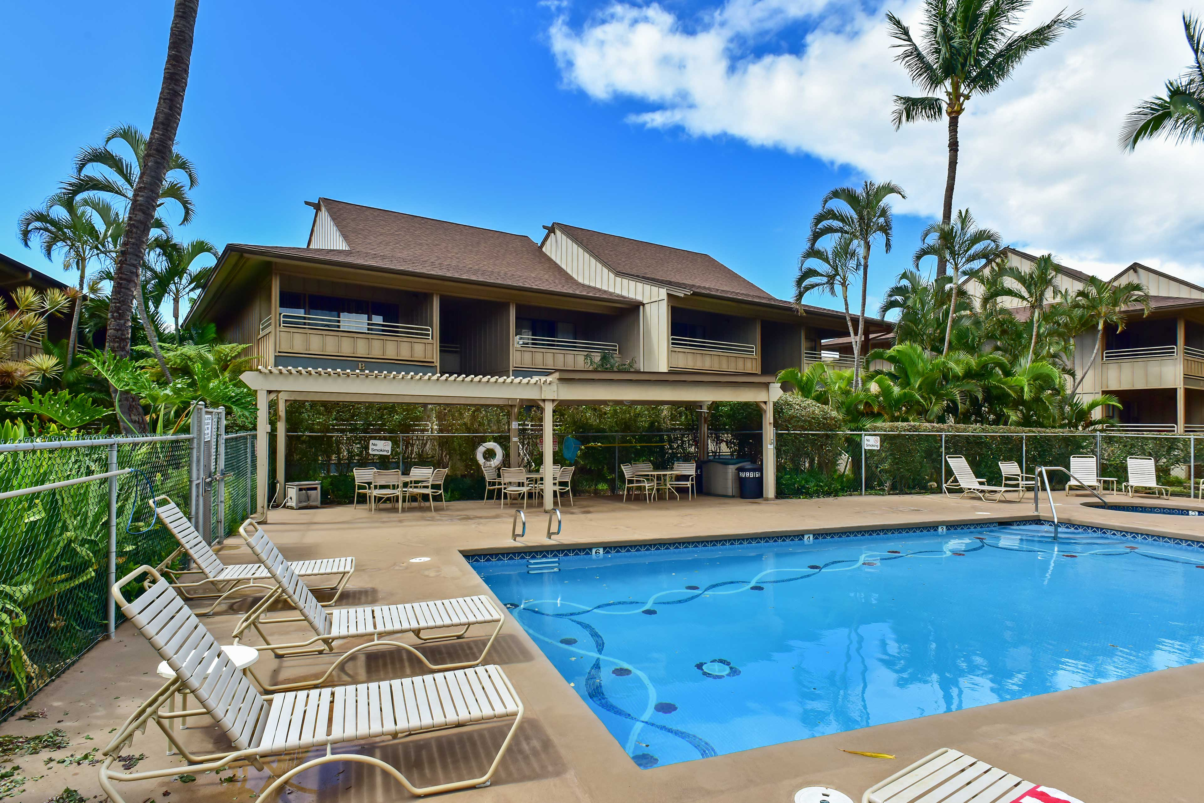Take a dip in the community pool to cool off at this condo in Kihei!