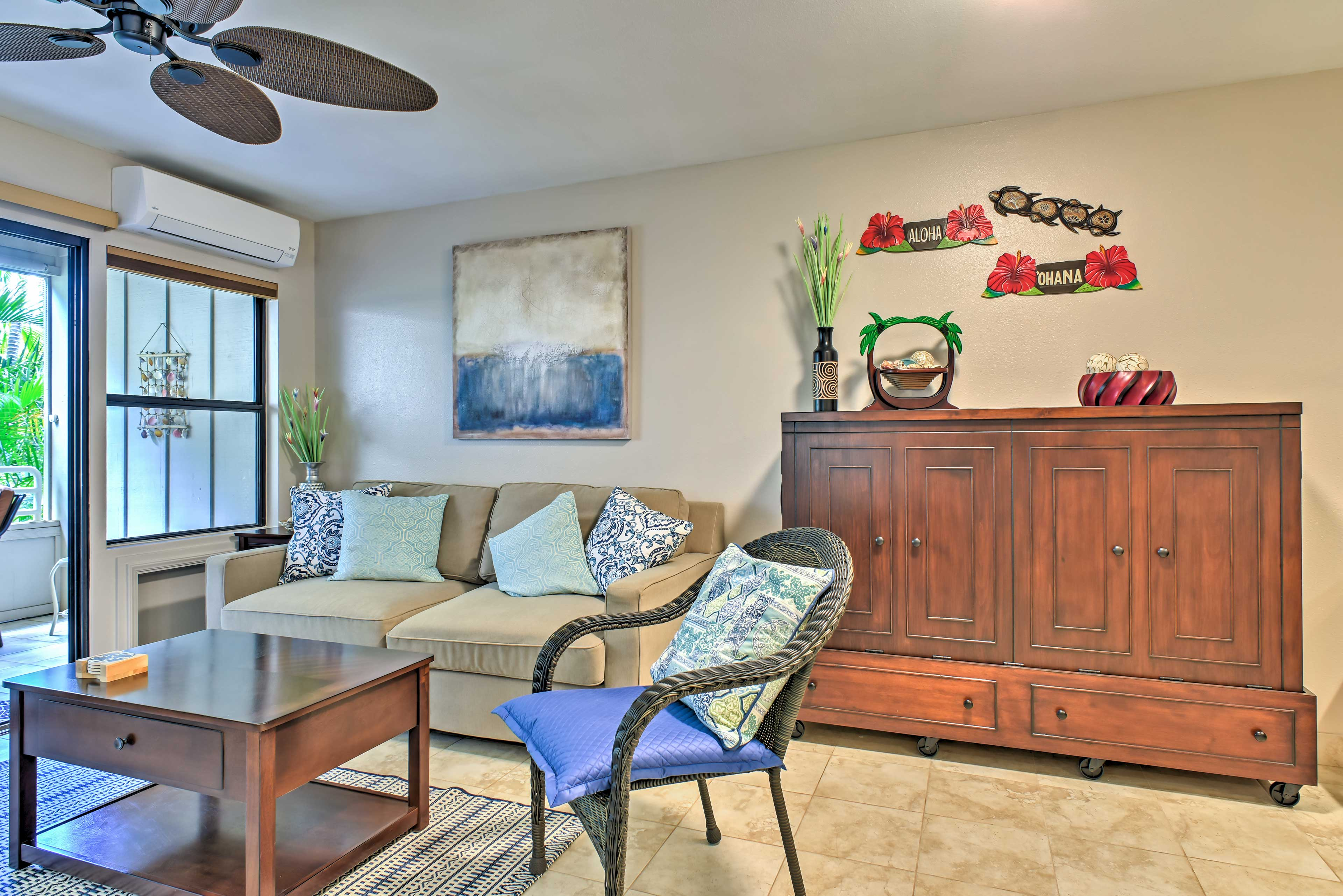 The living room boasts a queen-sized Murphy bed.
