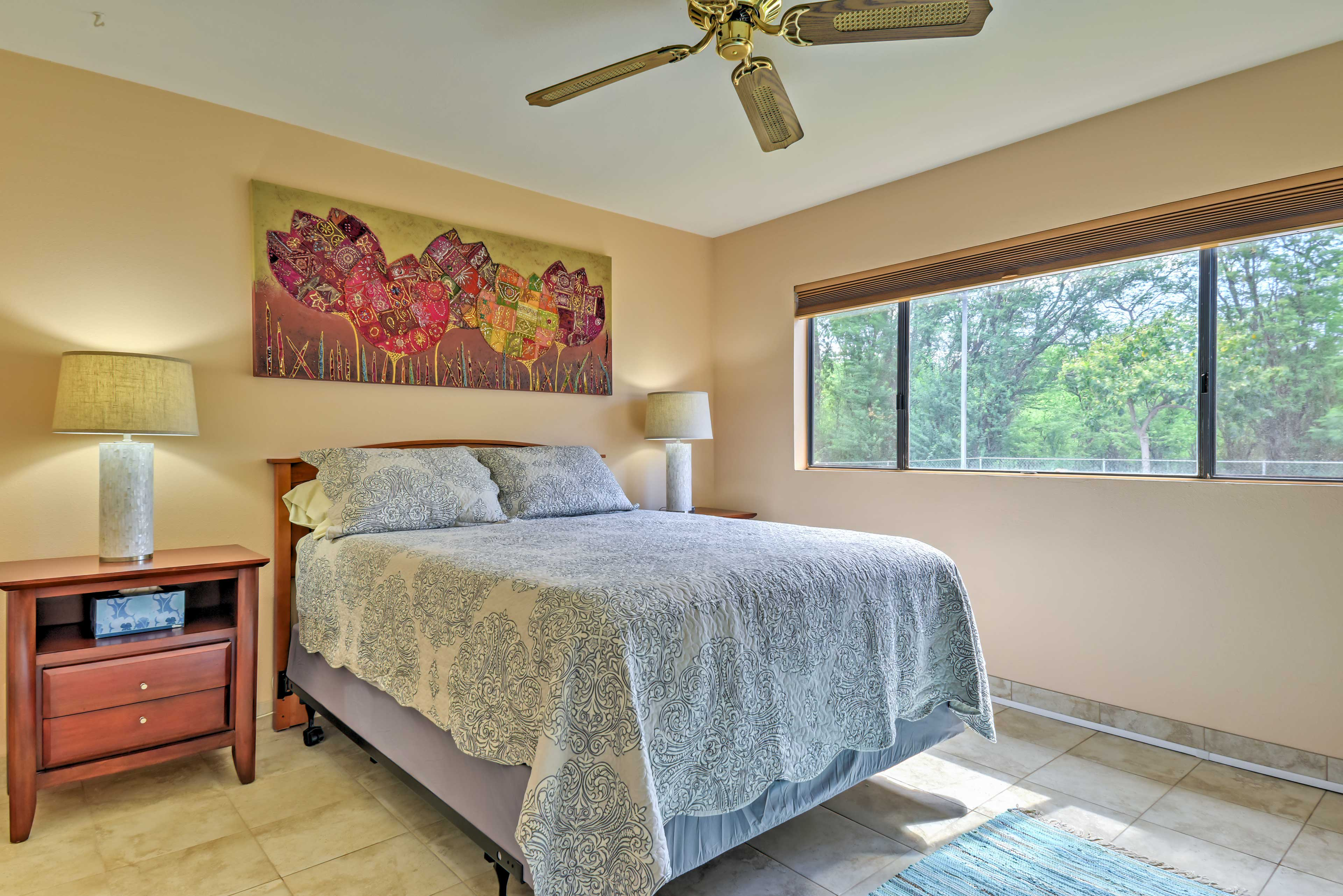 Step into the bedroom, which features a queen-sized bed.