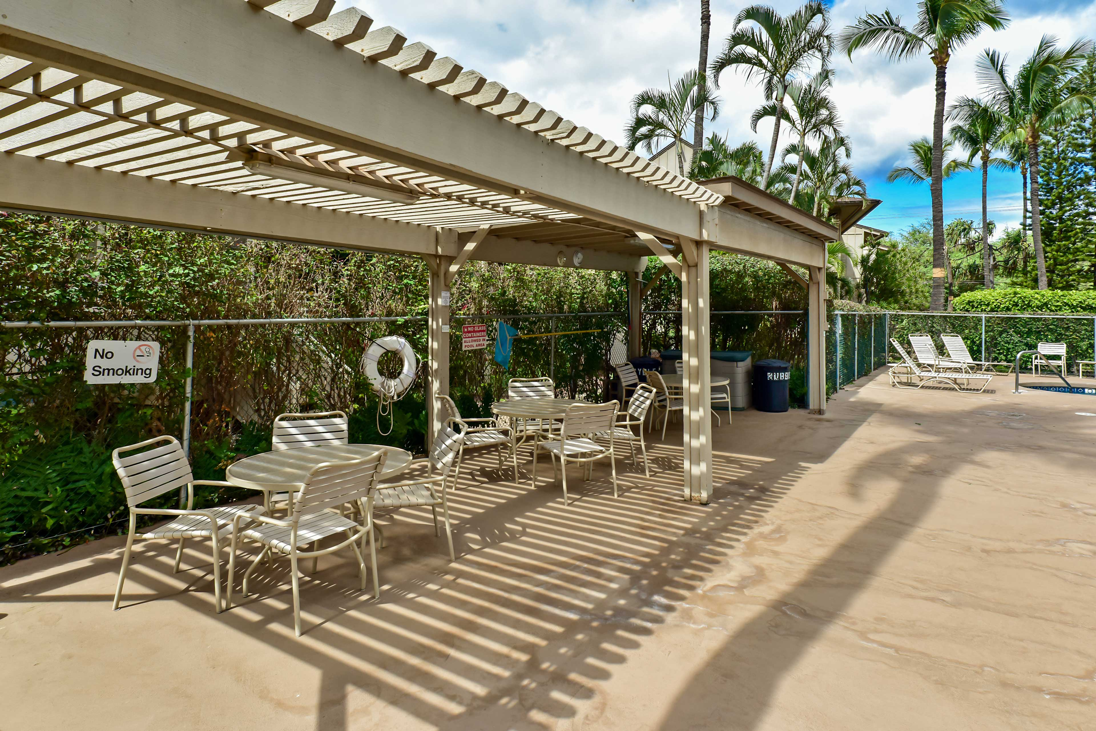 The pool area features a shaded area, where you can get a break from the sun.