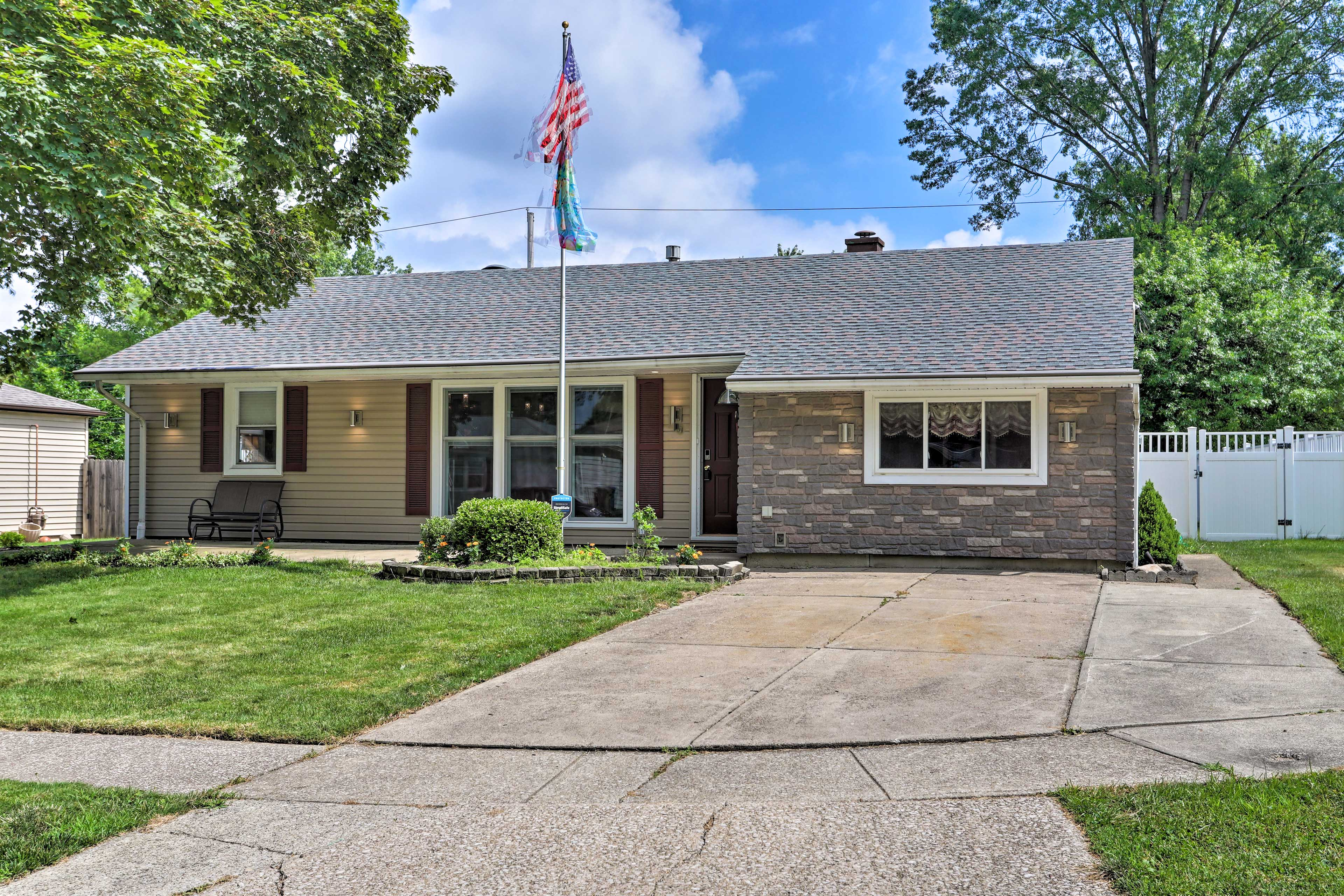 The cozy home is situated on a quiet, tree-lined street.