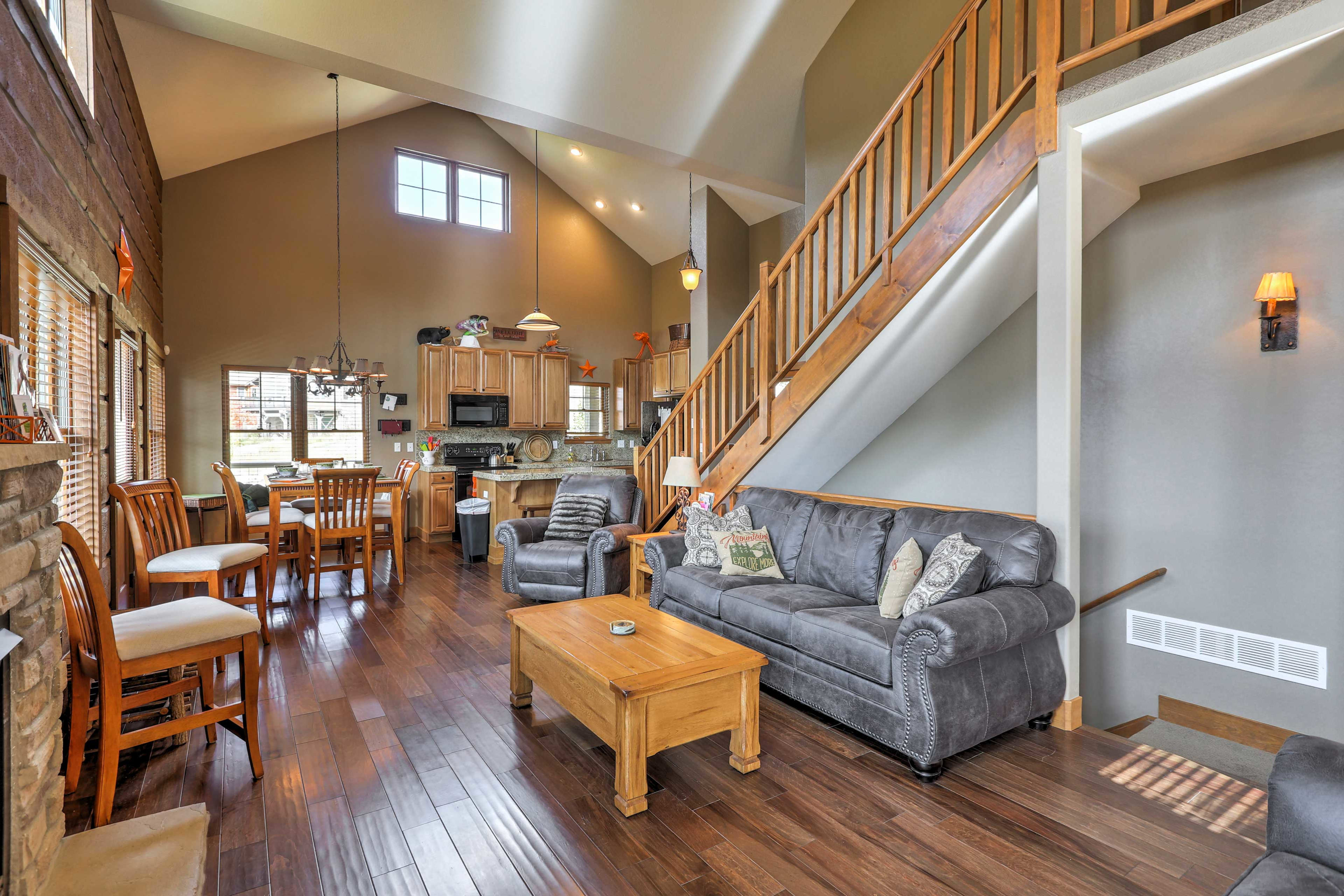 Walk over and turn on the gas fireplace in the living area.
