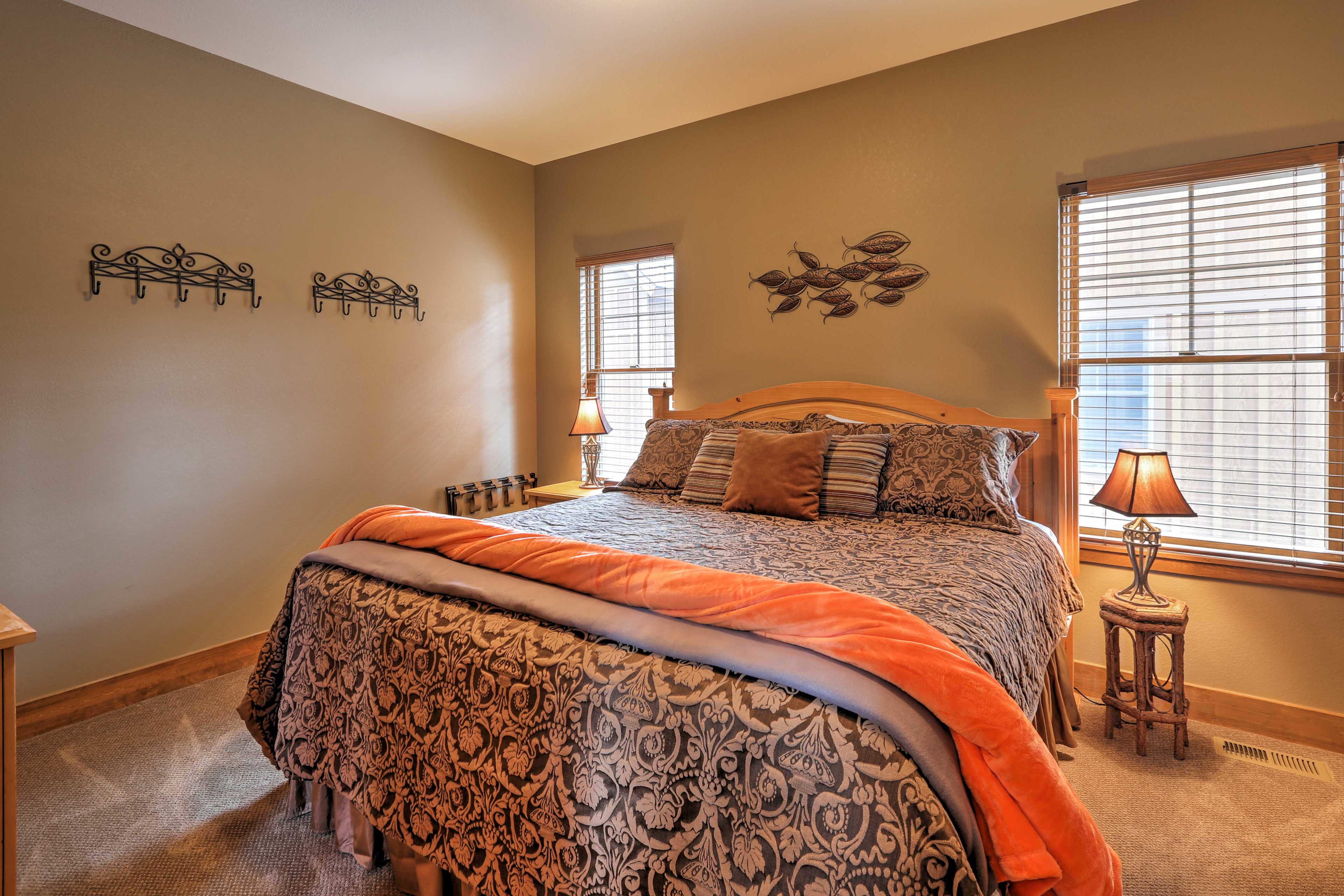 This bedroom offers a plush king bed.