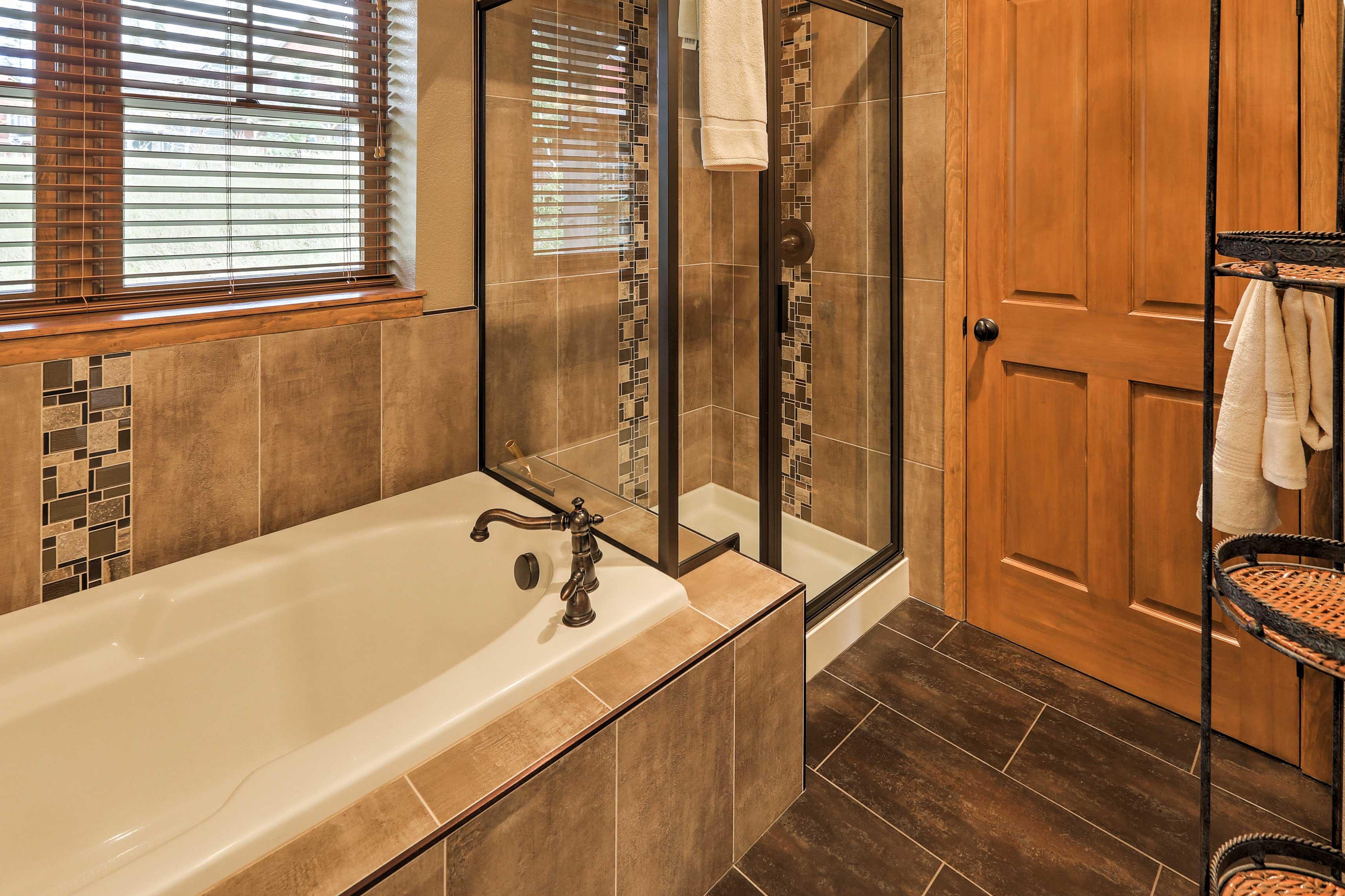 Soak in the master bathroom's bath tub.