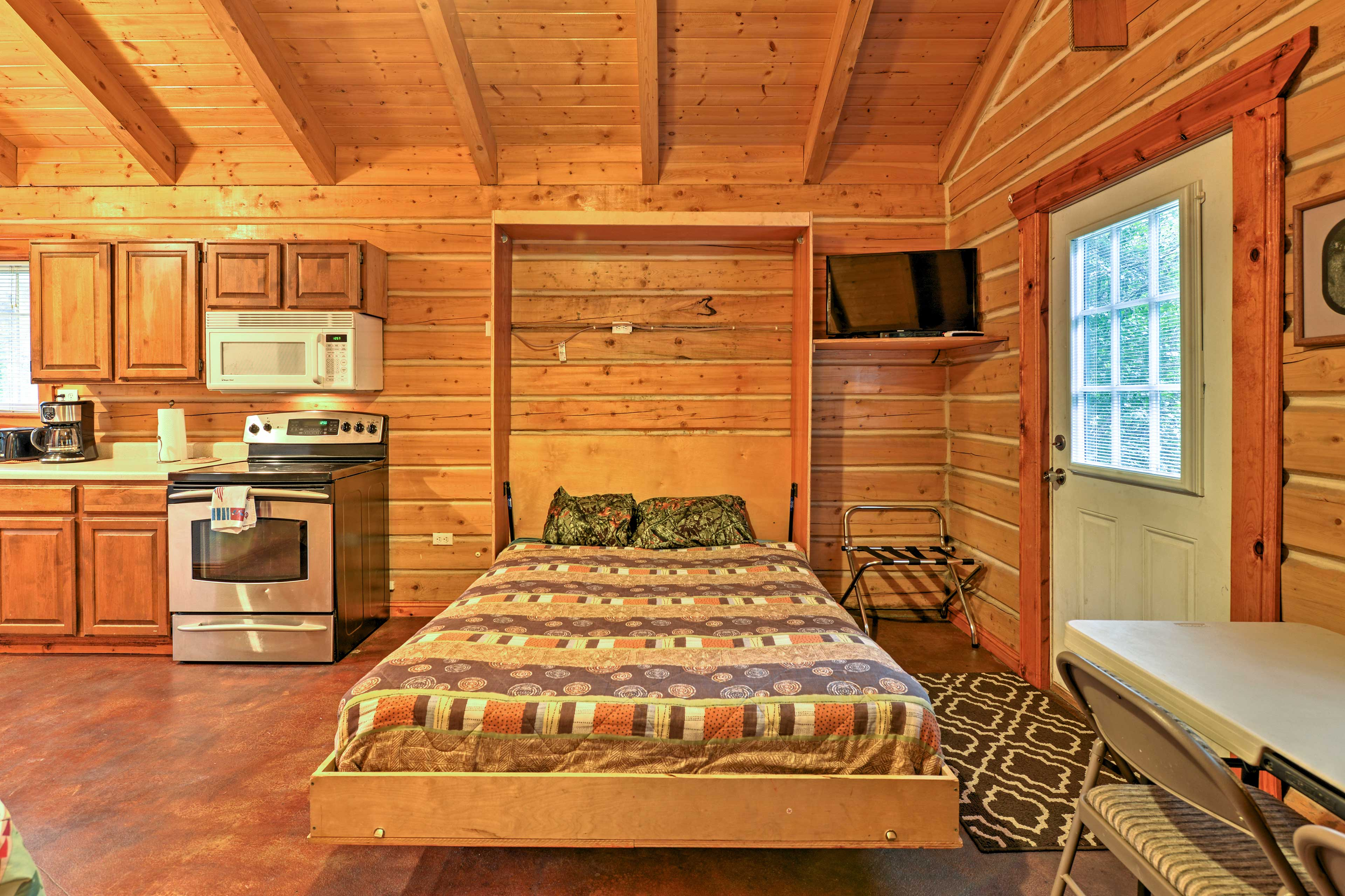 Pull down the Murphy bed for an additional queen bed to lie back on.