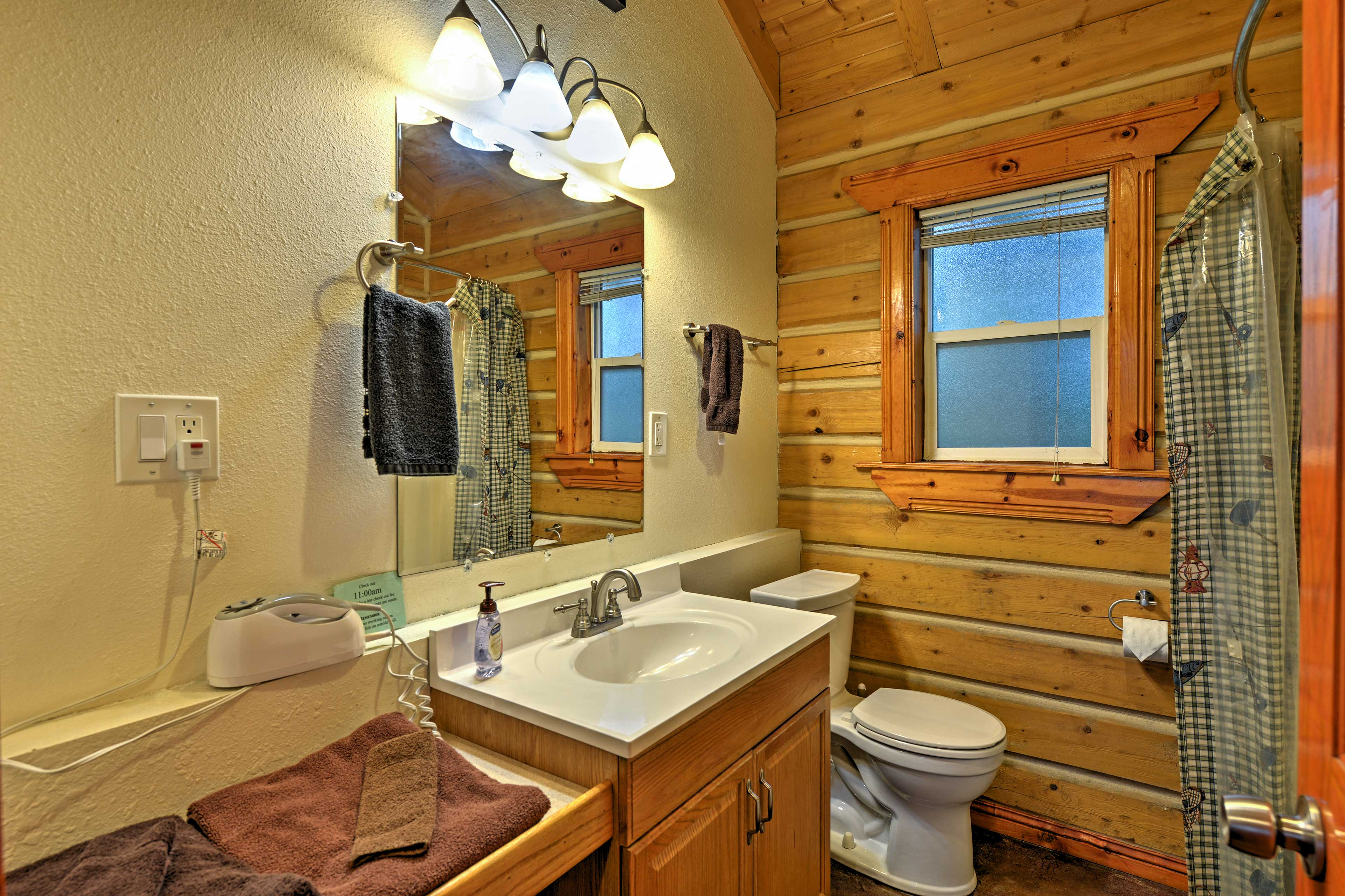 Clean off in the bathroom, which features a single vanity and shower/tub combo.