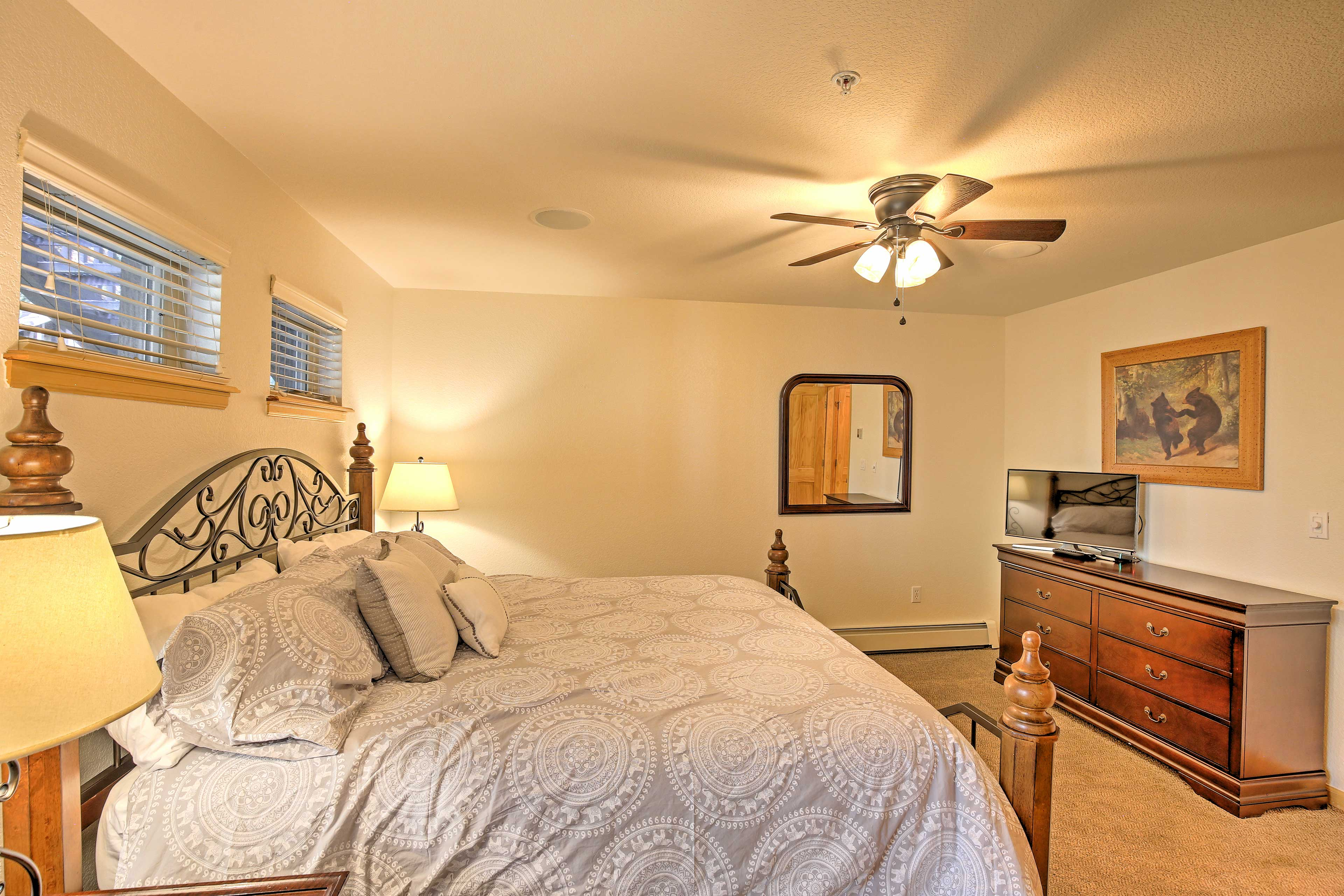 The master bedroom boasts a new king bed, digital TV, and an en-suite bathroom.