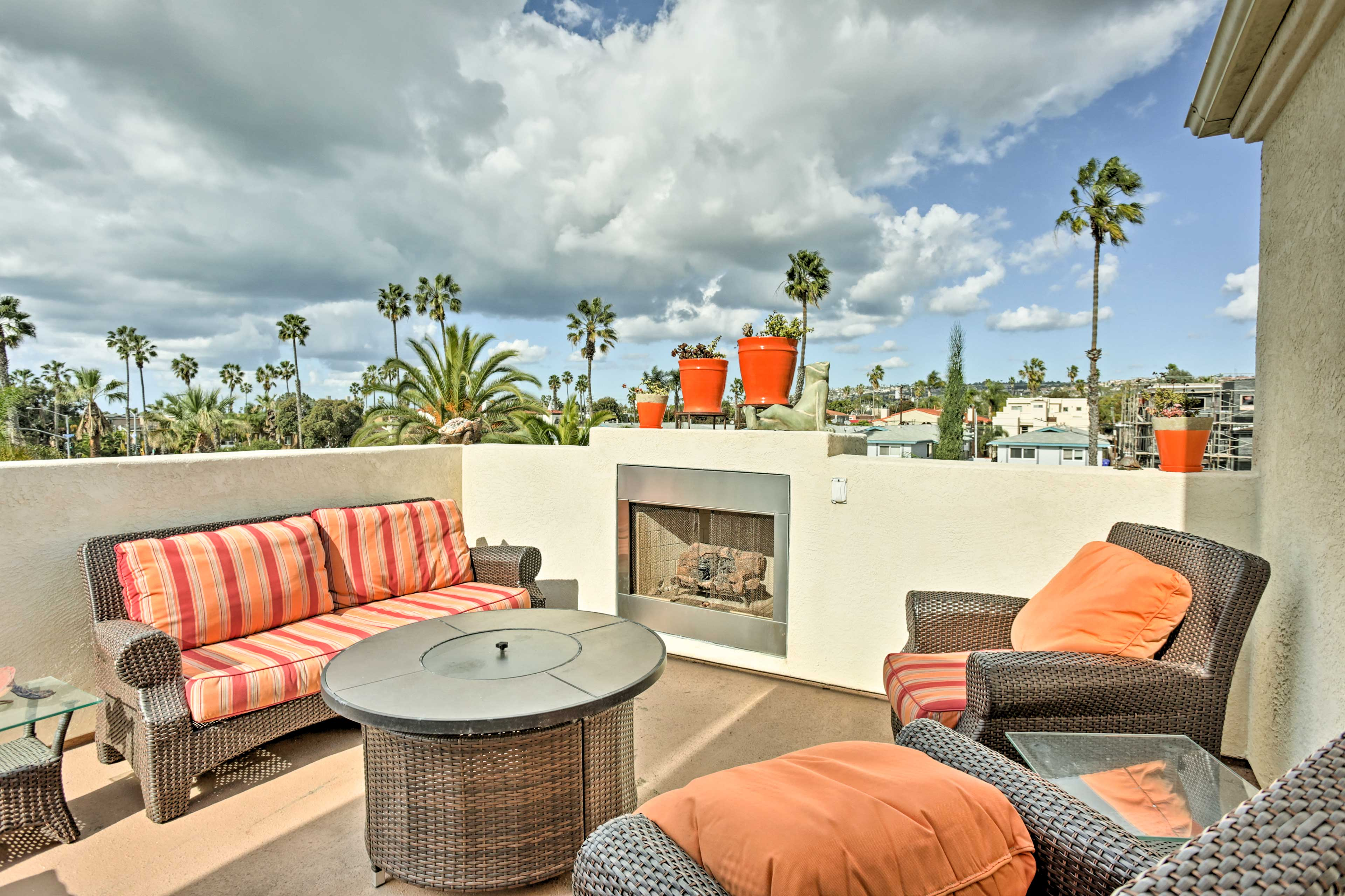 Soak up the sun from the private patio of this colorful 2BR, 2.5-bath townhome!