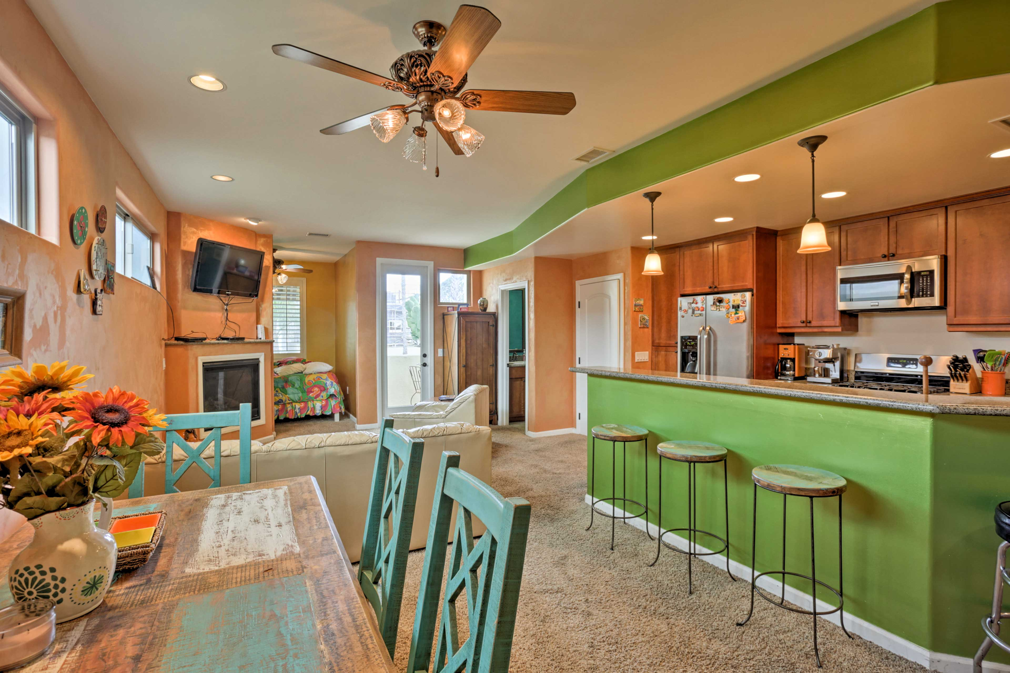 Inside, the charming home boasts 1,400 square feet of vibrant living space.