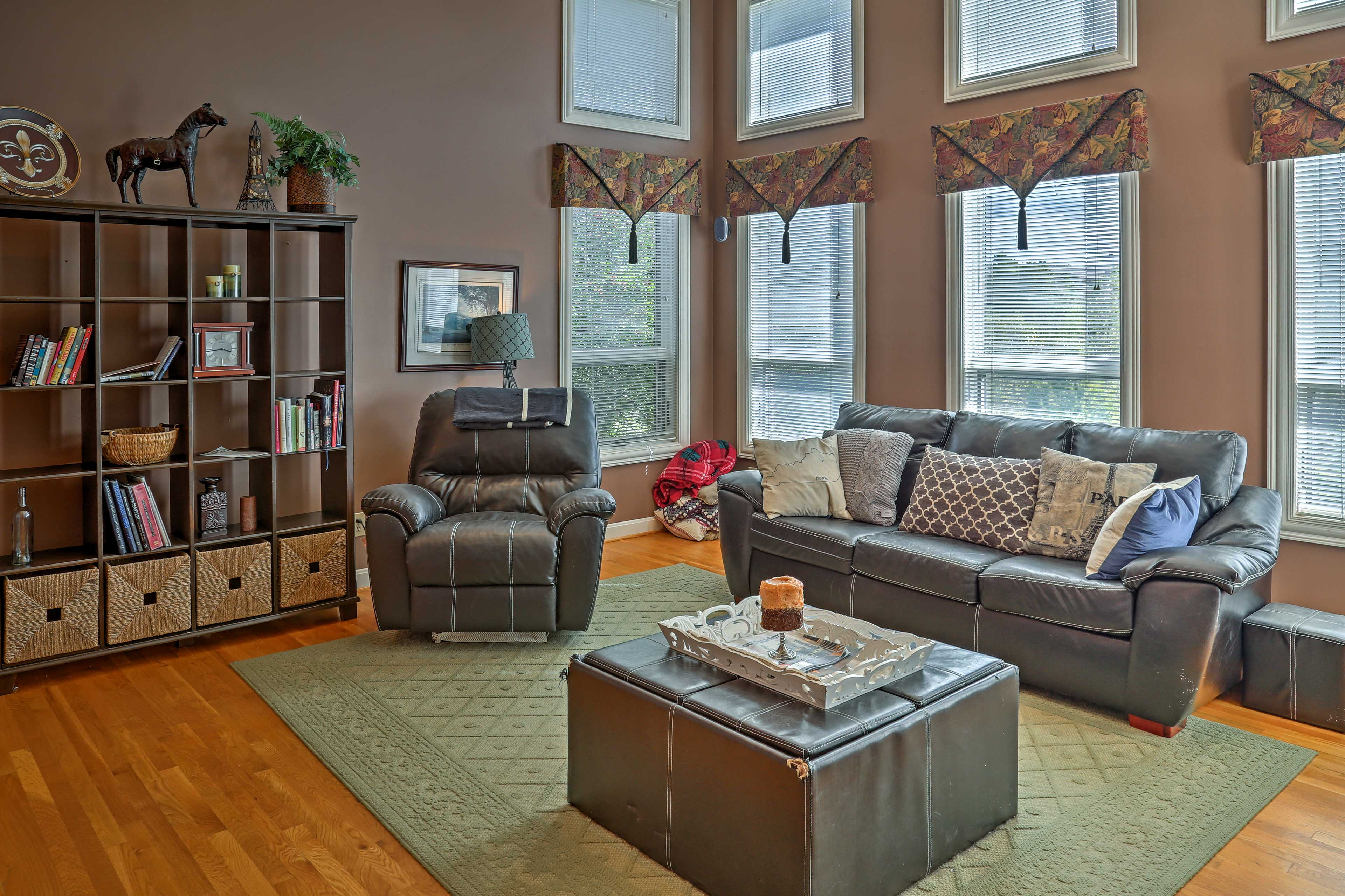 Kick back in the living room as light pours in from the floor-to-ceiling windows.