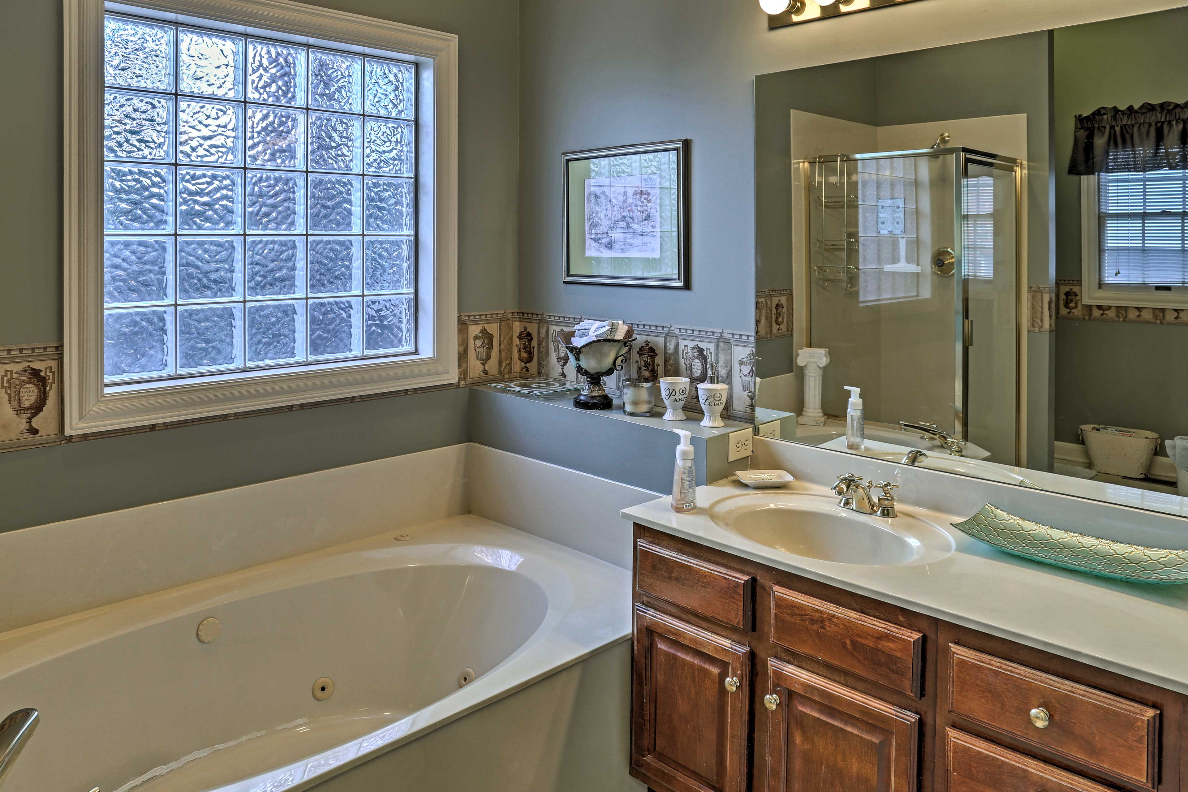 This en-suite bathroom offers a spacious tub.
