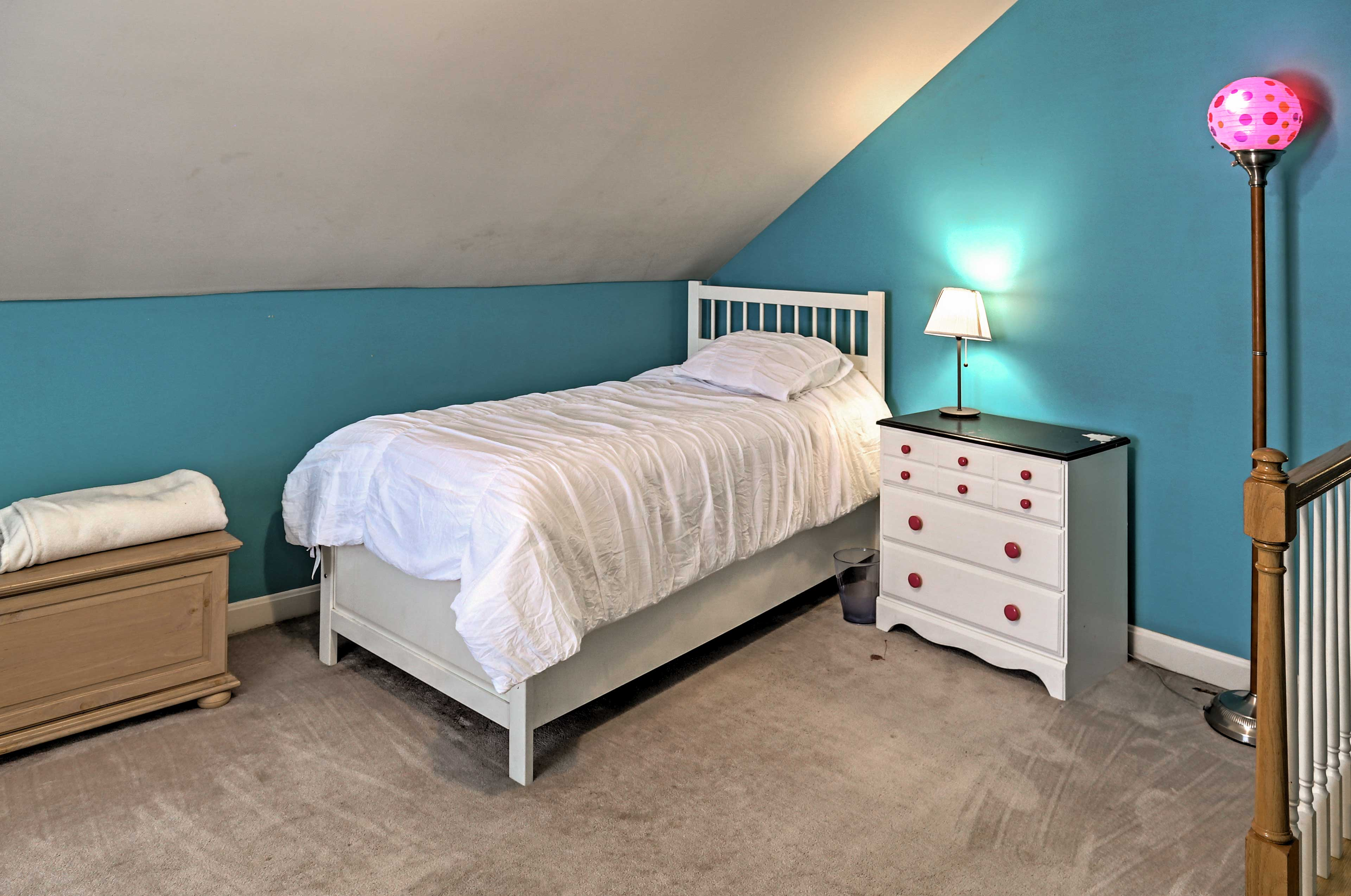 Kids will love this vibrant room with a twin bed.