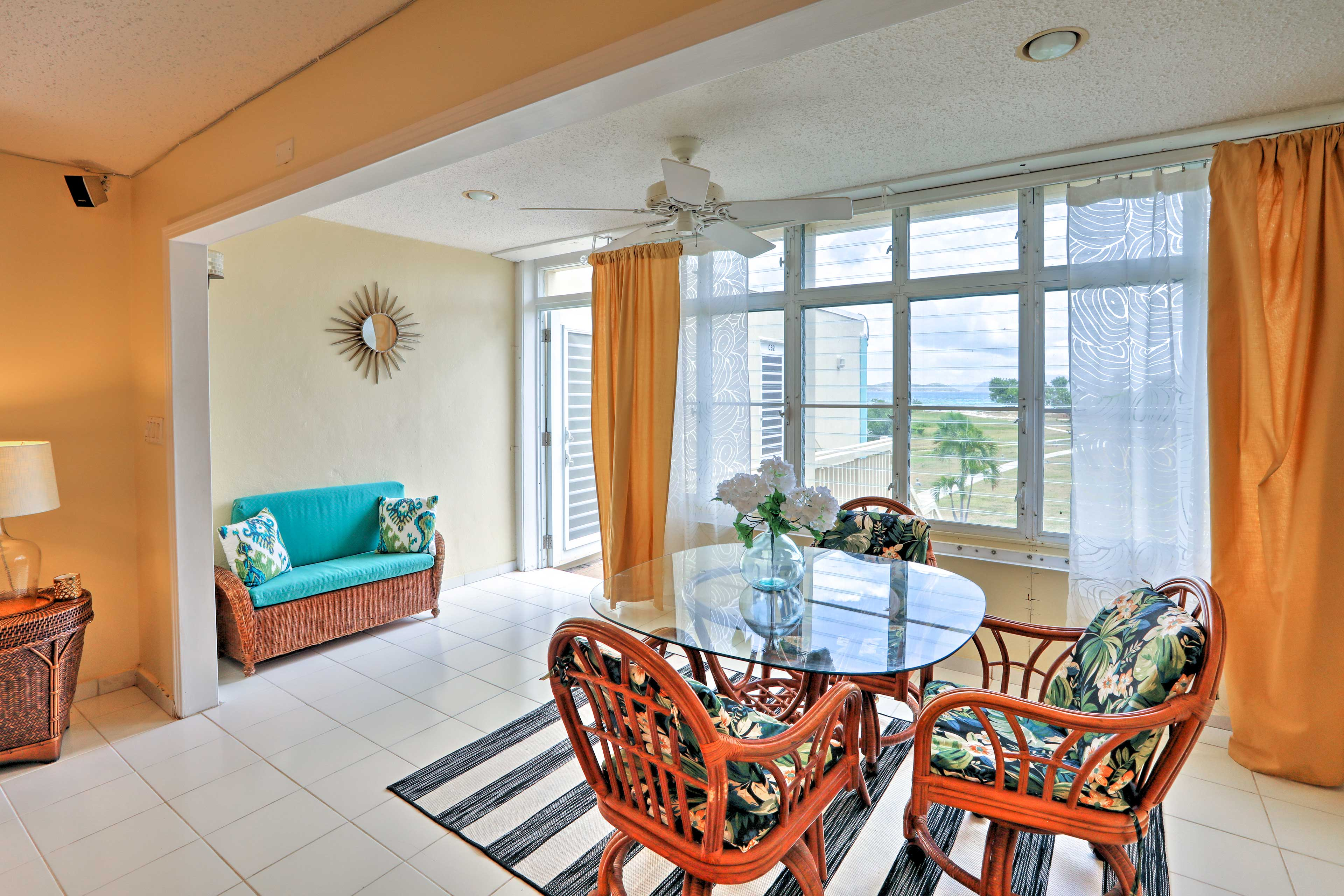 Views from this airy unit include that of premier landscaping outside!