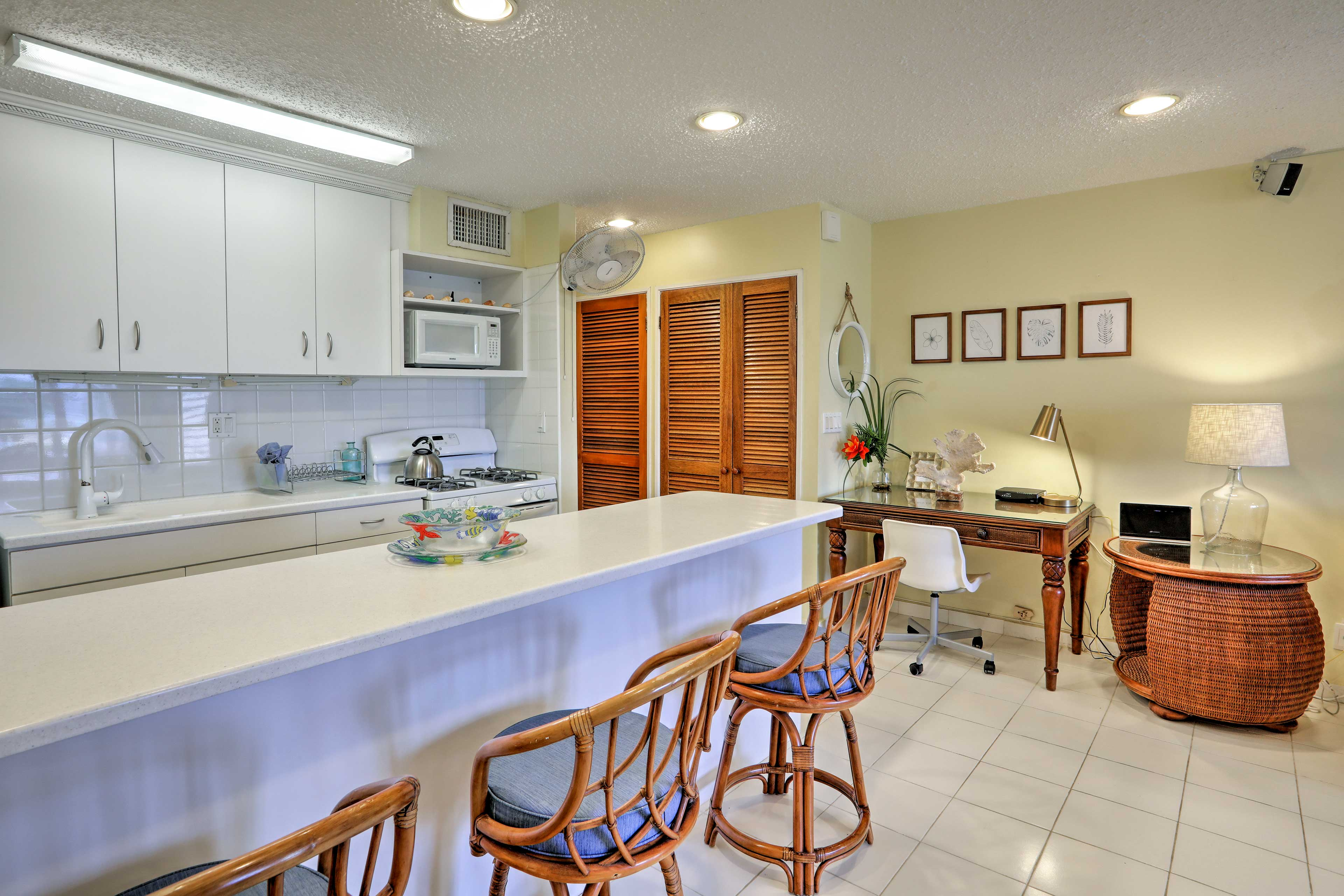 Crisp white counters & cabinetry is featured in the fully equipped kitchen.